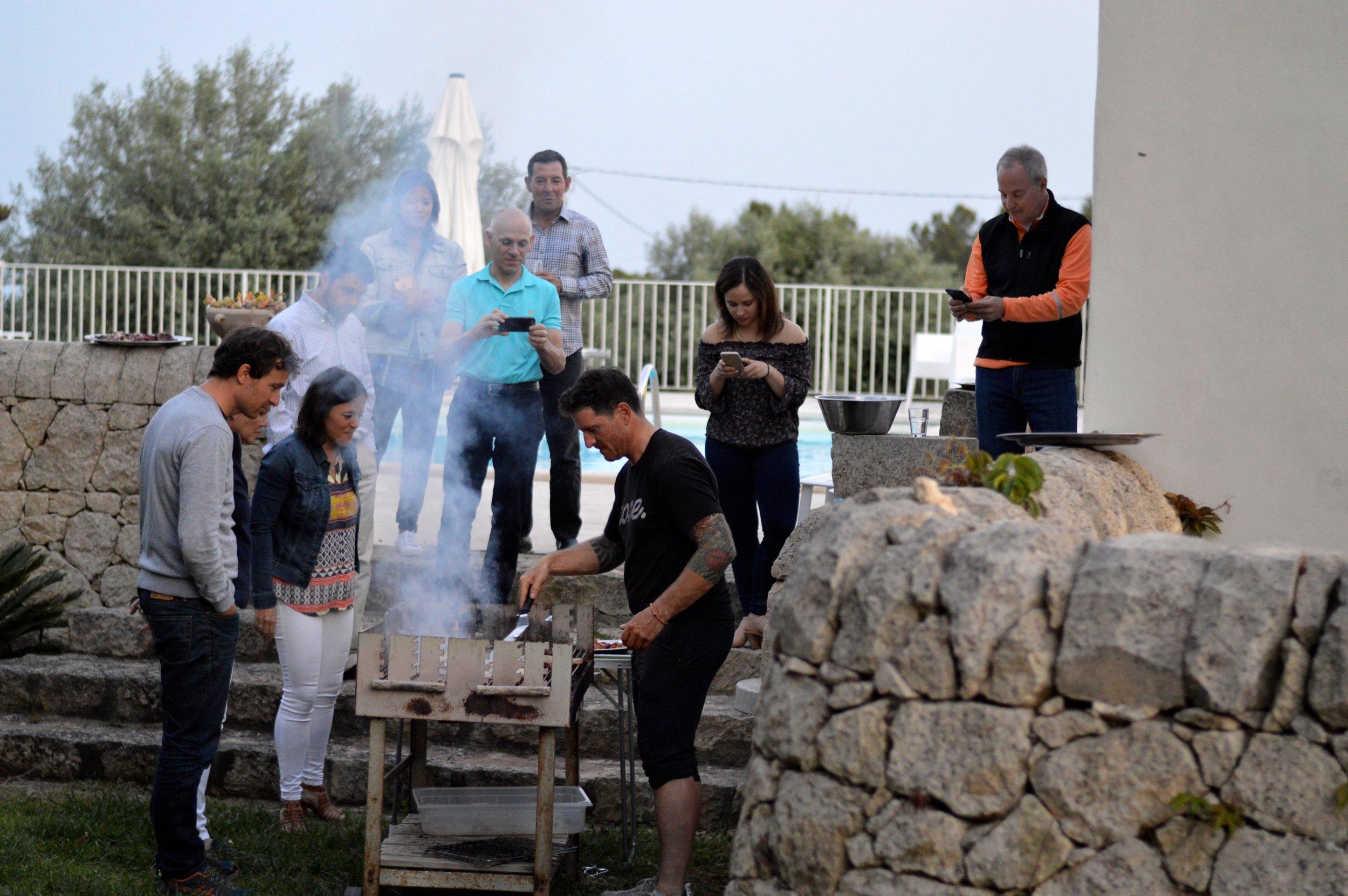 Seamus Mullen preparing dinner for guests in Sicily