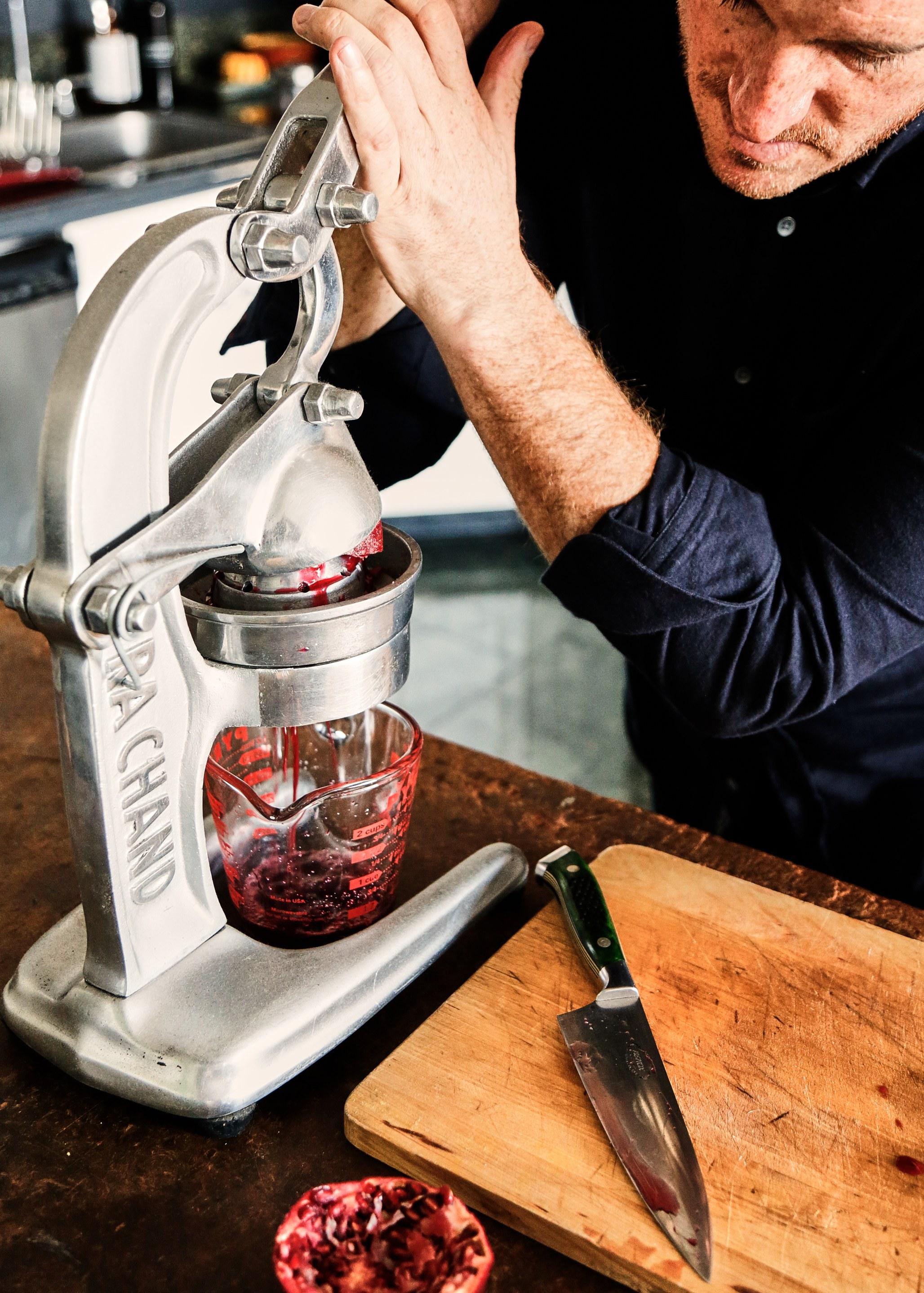 Seamus Mullen in his kitchen making fresh pomegranate juice