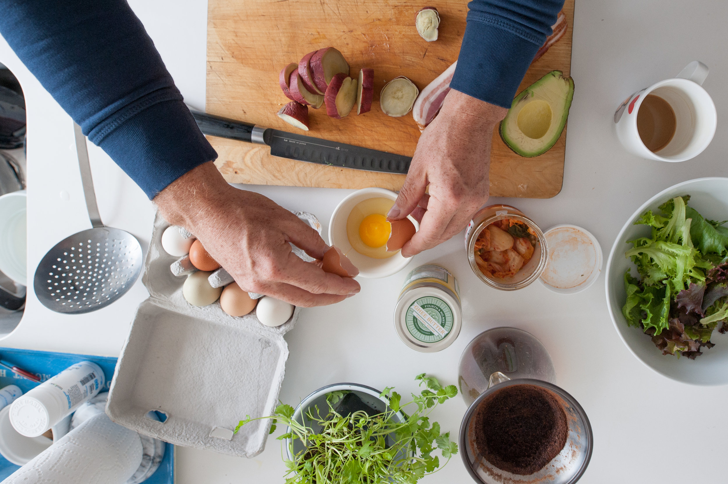 Seamus Mullen's kitchen counter as he prepares a meal with eggs and avocado