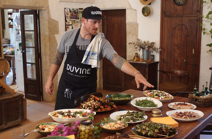 Seamus Mullen cooking for guests on Duvine Chef On Wheels Bike Tour