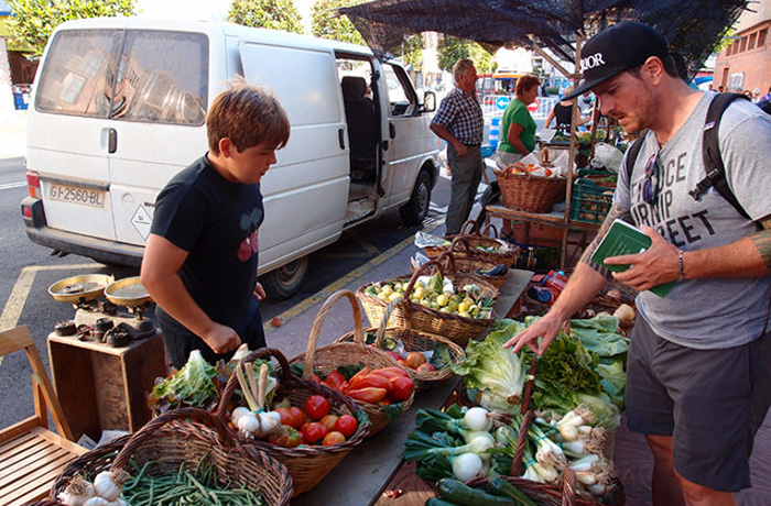 Seamus Mullen buying vegetables in a market in Italy