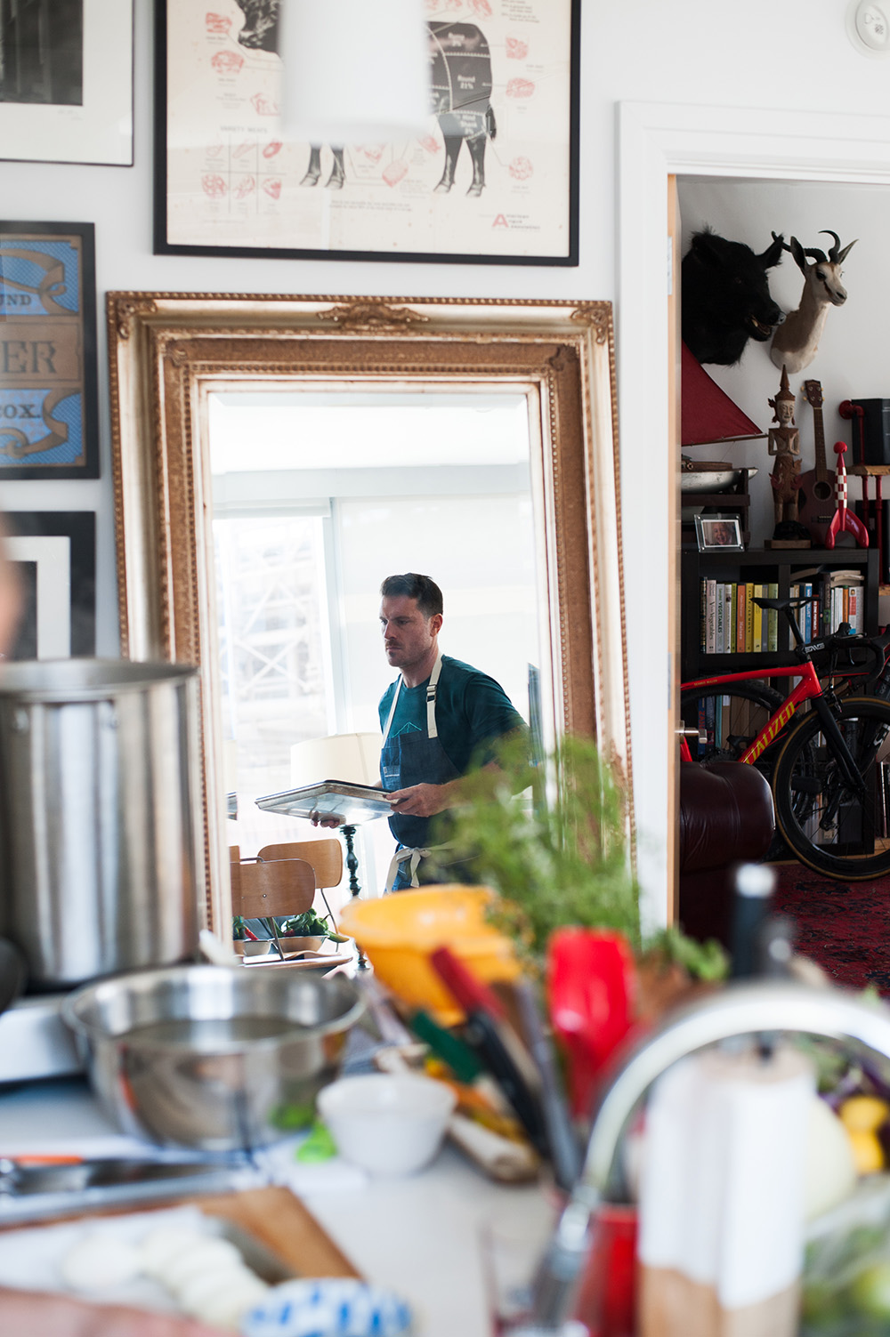 Seamus Mullen prepares dinner in his Dumbo apartment