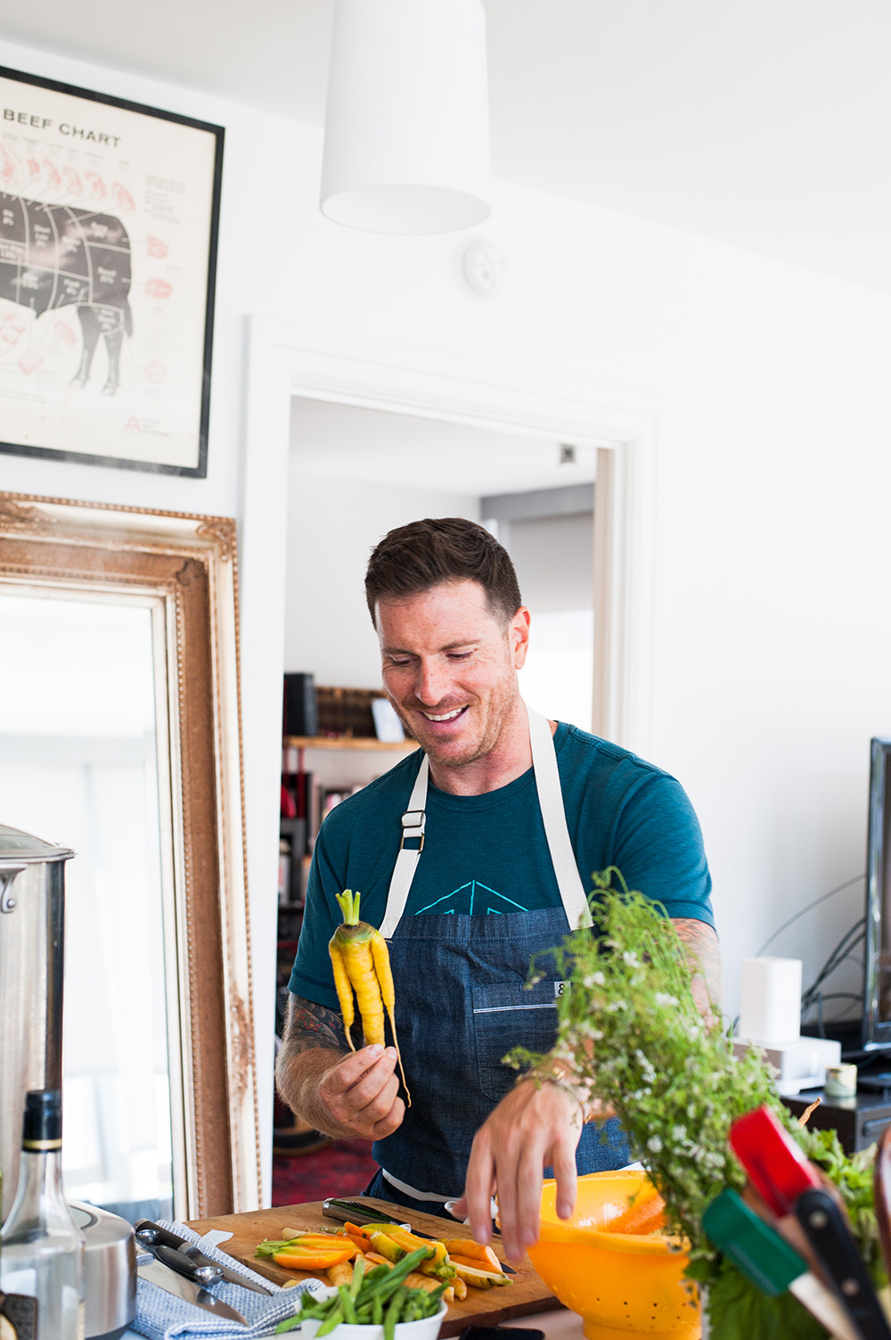 Seamus Mullen laughs at a strangely shaped golden carrot