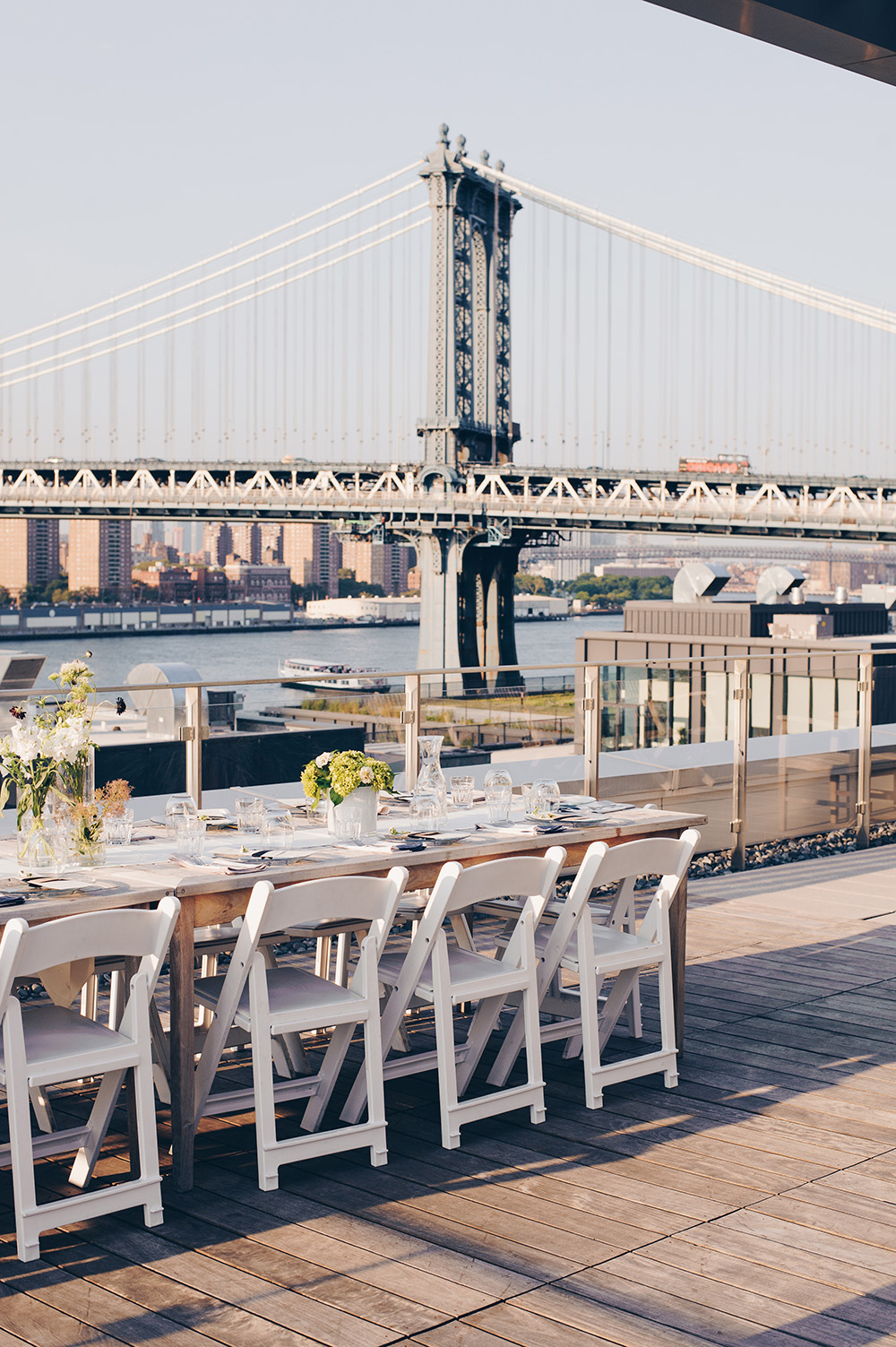 Rooftop dinner table with Williamsburg Bridge in background