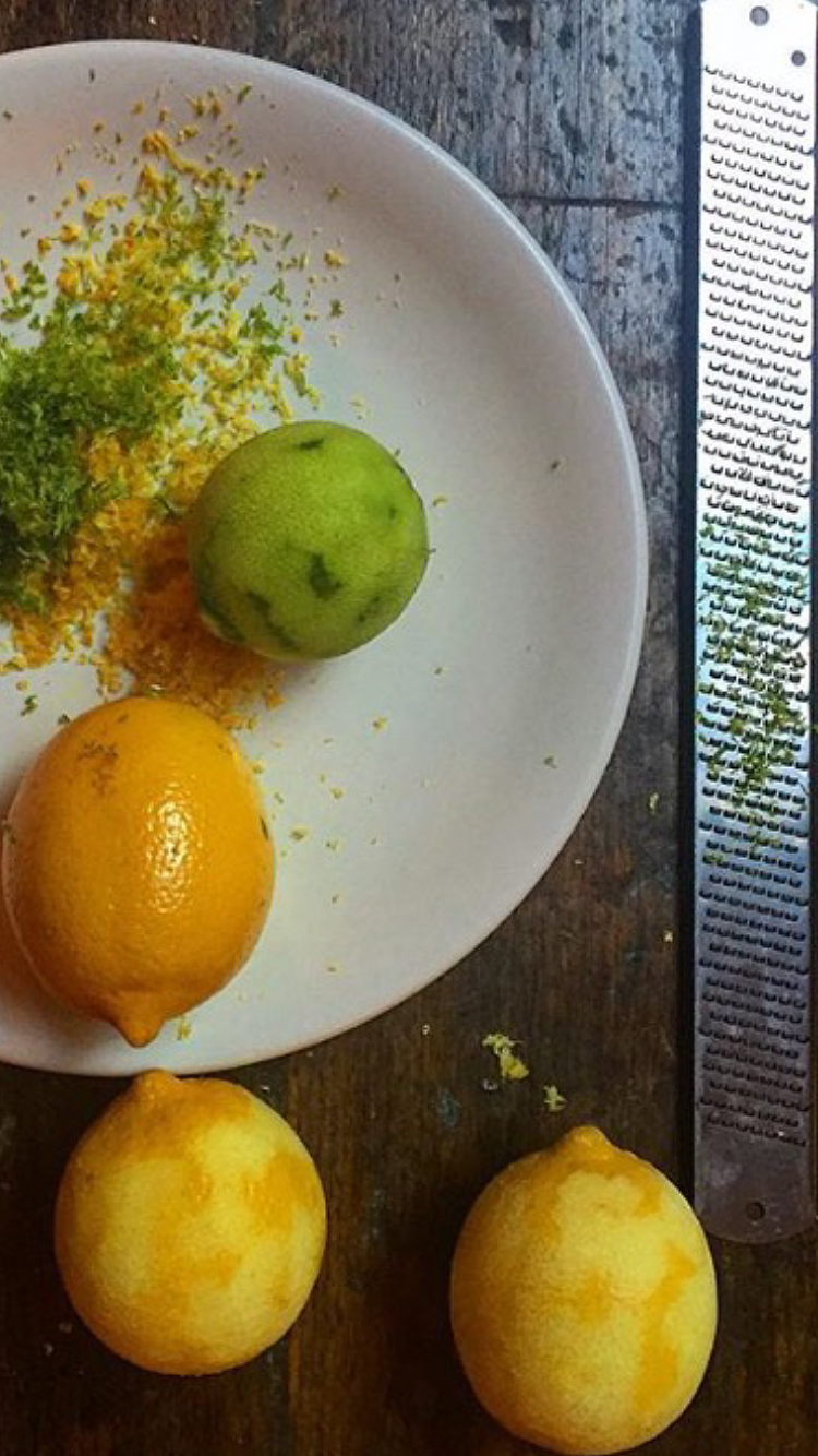 Using a microplane to zest citrus