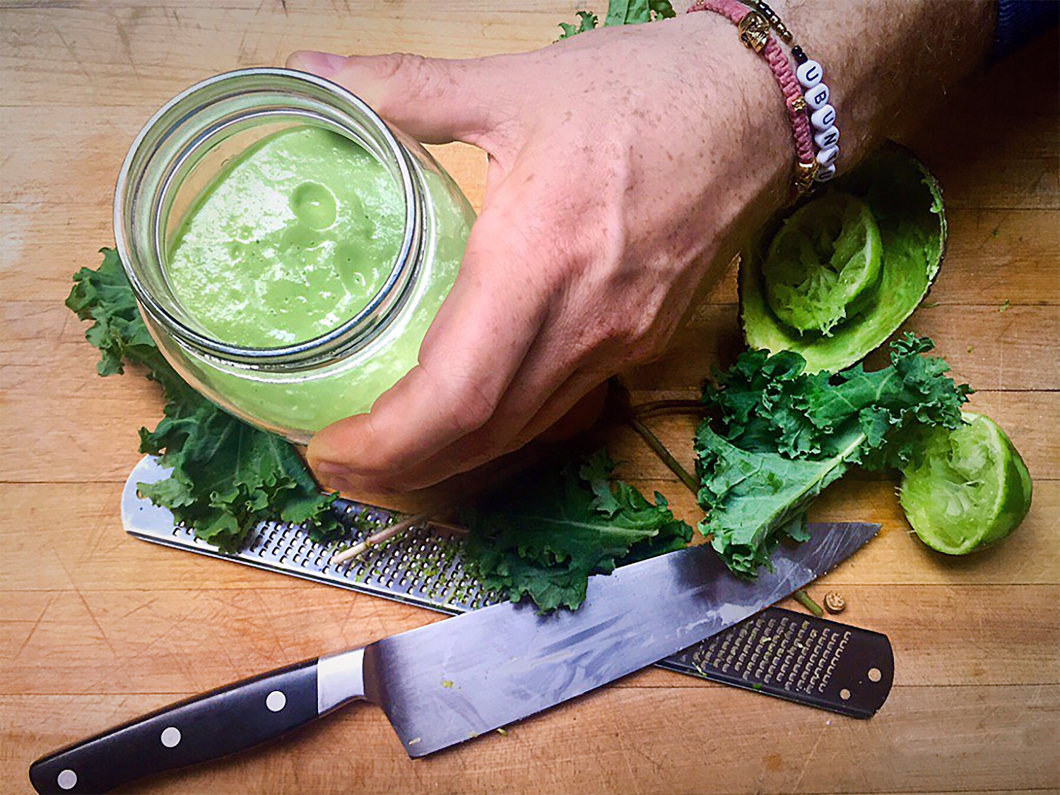 Avocado and kale salad with green Vinaigrette prepared in a mason jar