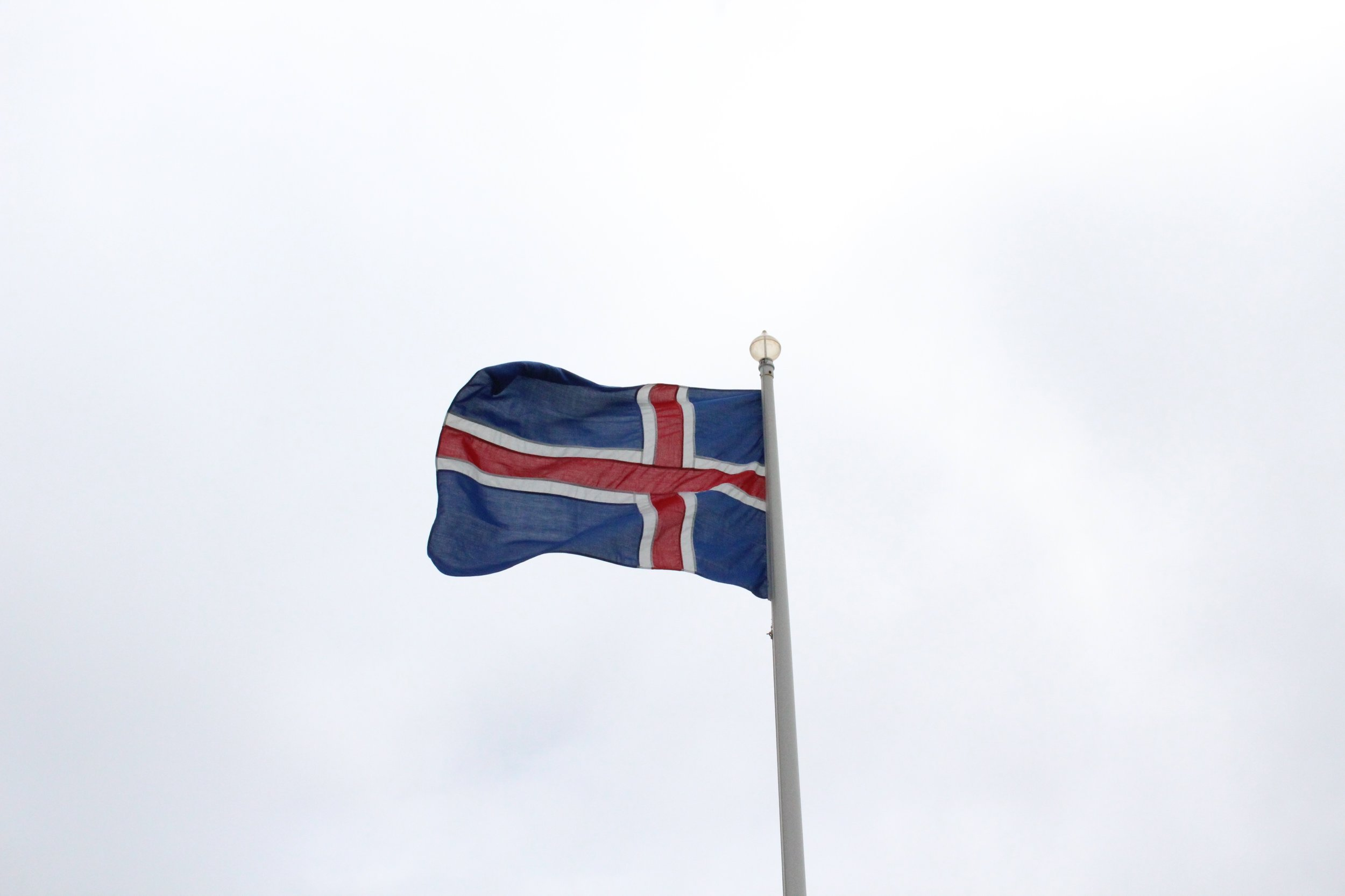 The Icelandic flag is always waving in windy Iceland.