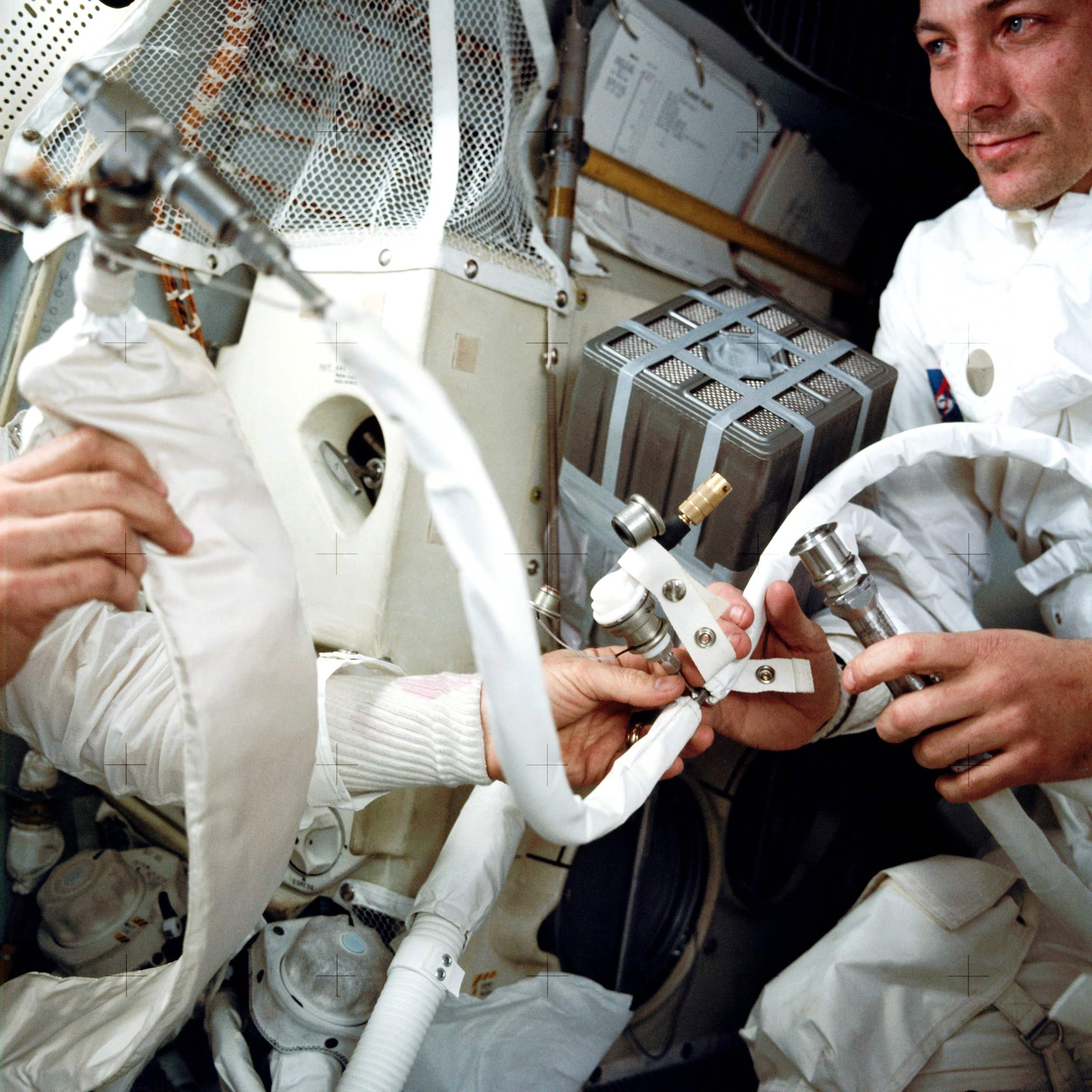 The Apollo 13 crew assemble the improvised CO2 canister.