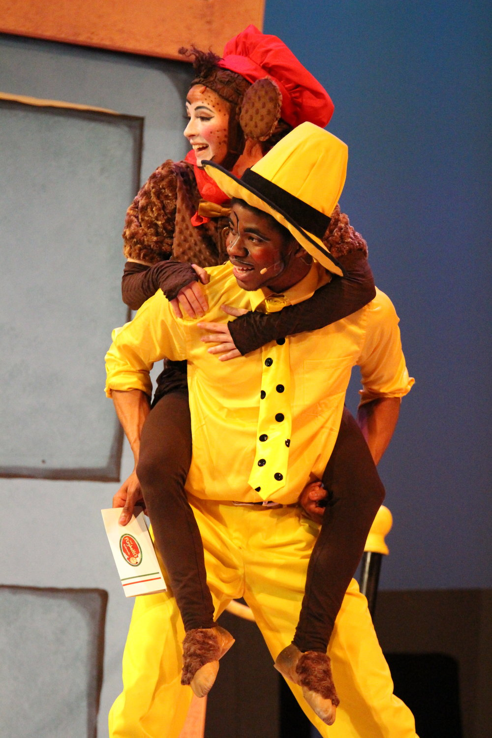 Curious George & the Golden Meatball , based on the books by Margret and H.A. Rey, with music by John Kavanaugh and book and lyrics by Jeremy Desmon. Directed by Stephanie Jacobson, choreography by Sue Gillespie Booton and music direction by Jerry Brabec. Omaha Theatre Company, The Rose Theatre.  Photo by Alex Myhre .