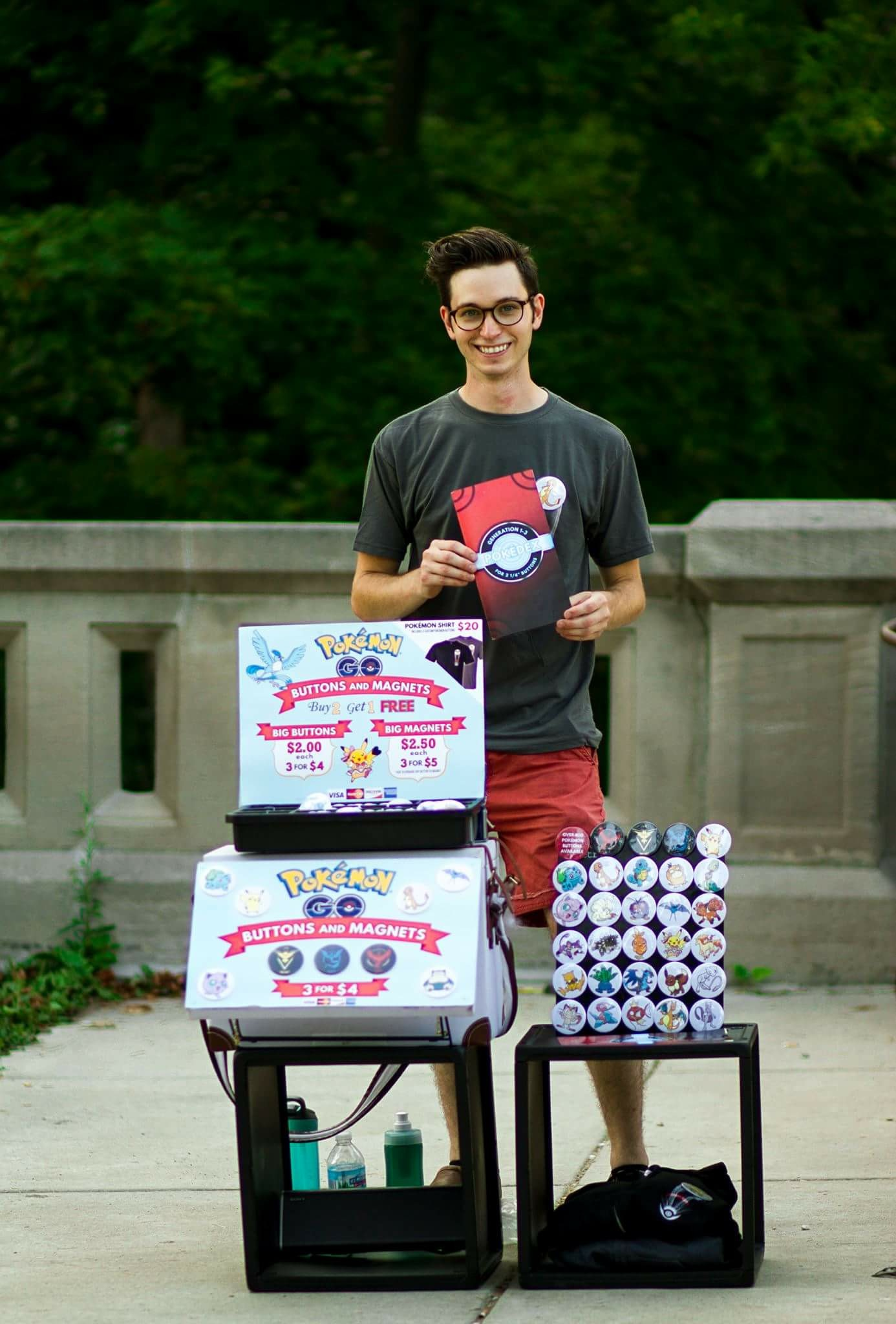 Desperate to pay his bills Stephan sells Pokemon buttons at Lake park to players of the Pokemon Go craze 2016.