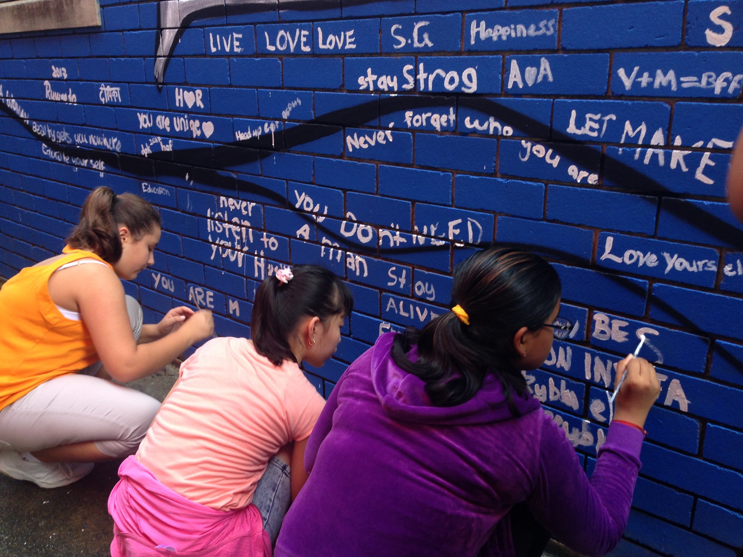 "Young ""artivists"" from Liverpool Girls contributing to the community mural."