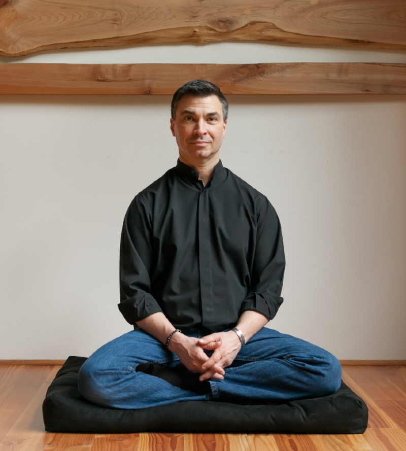 Dr. Jeff Tarrant sits in a common meditation pose inside of his Meditation Institute in Corvallis, OR.