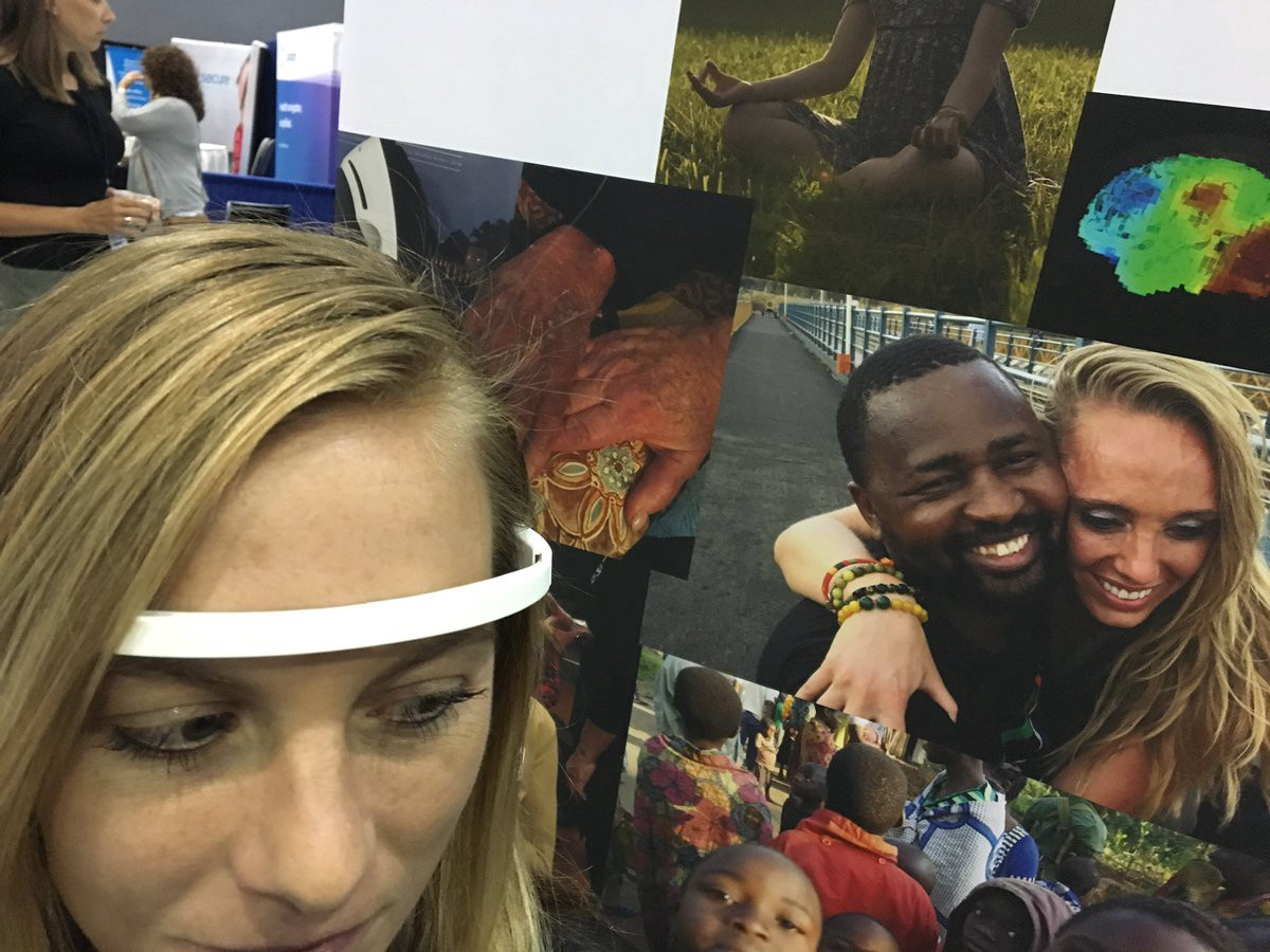 "A Woman prepares to demo ""Positivity"" at the Employer Healthcare Congress in LA wearing a Muse Meditation Headband"