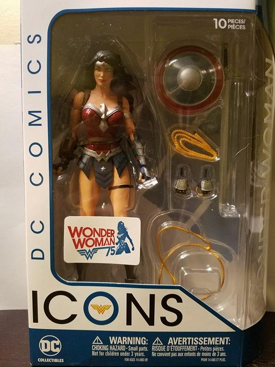 The Packaging is nice in clean with a sticker celebrating Diana's 75th anniversary. You can also see all of her accessories. She comes with two extra hands, one closed and one open lasso, and her shield and sword.