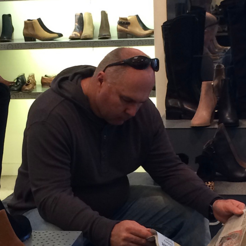 My patient husband reading the paper while I shop for shoes… Yes I know how lucky I am!
