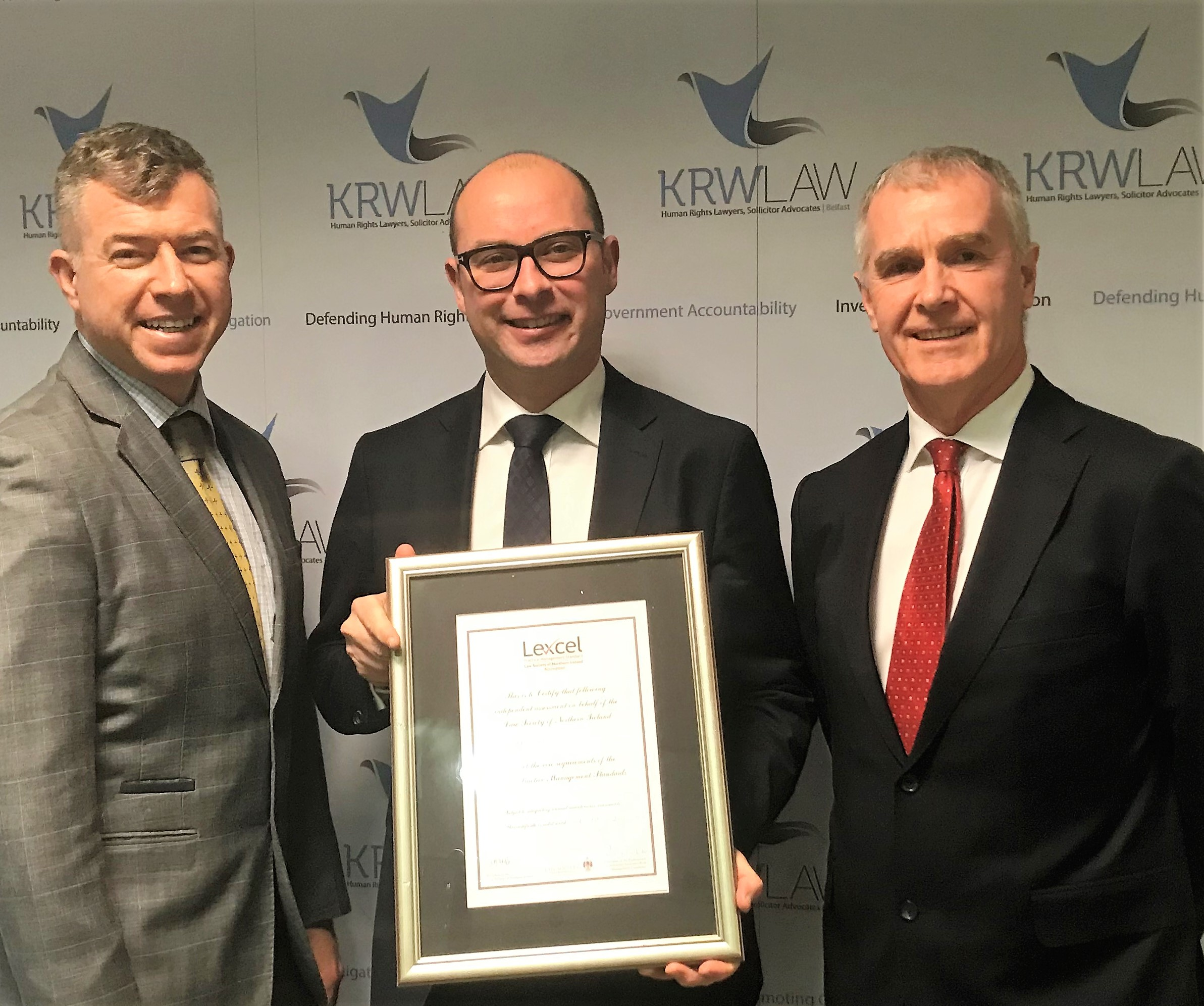 Martin Rice (CEO Next Level Impact) presents Gerard McNamara (Partner) and Jim Clinton (Office Manager) of KRW Law with their Lexcel Certificate.
