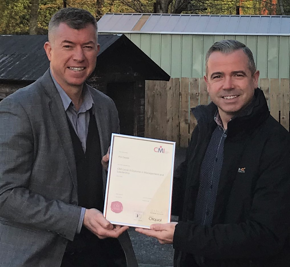 Martin Rice (CEO Next Level Impact) presents Pól Deeds (CEO An Droichead) with his Level 5 CMI Diploma in Management and Leadership.