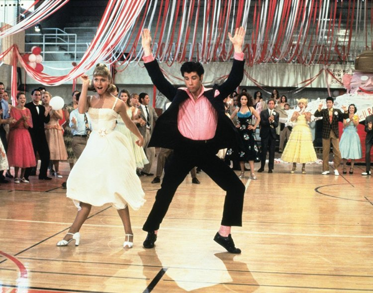 Grease (1978) - This one's also a true classic! I've loved this movie since junior high and when Glee made a tribute episode for the movie, I relived the wonderful experience and watched the original movie again and again. I mean, I even know every song AND the dance numbers in this movie. My most favorite are We Go Together, Summer Nights, You're the One That I Want, and Hand Jive. Also, Hopelessly Devoted to You is a great sing-a-long tune. The movie's hands down one of the must-watch musicals out there!Image credit: groknation.com