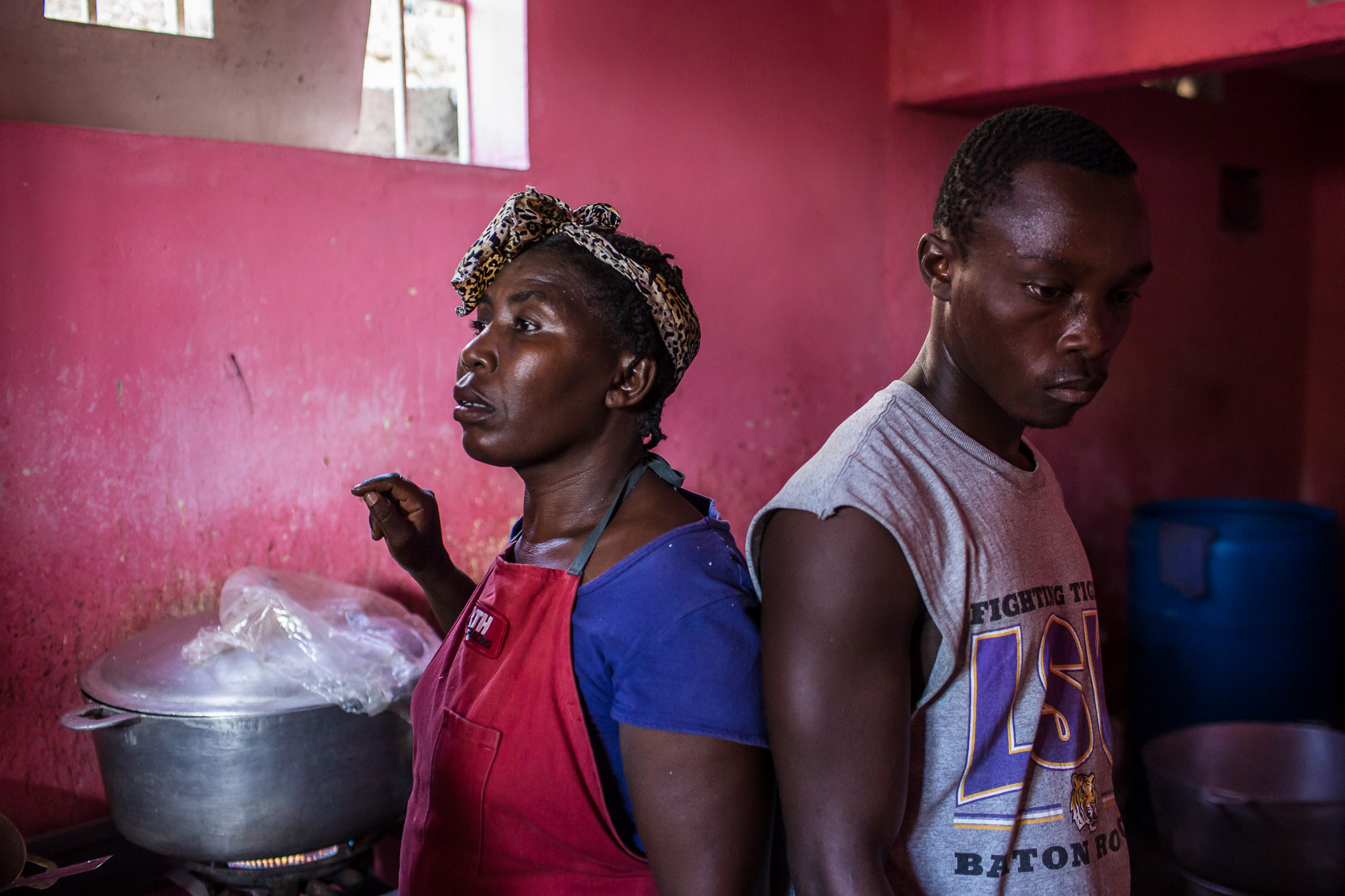 Kitchen workers at a restaurant in the Tapis Rouge neighborhood on Monday, December 22, 2014 in Port-au-Prince, Haiti. The restaurant was initially funded as a government program, and is required to serve meals that cost the equivalent of less than 25 cents US, which both provides cheap food for residents and a local business for entrepreneurs.