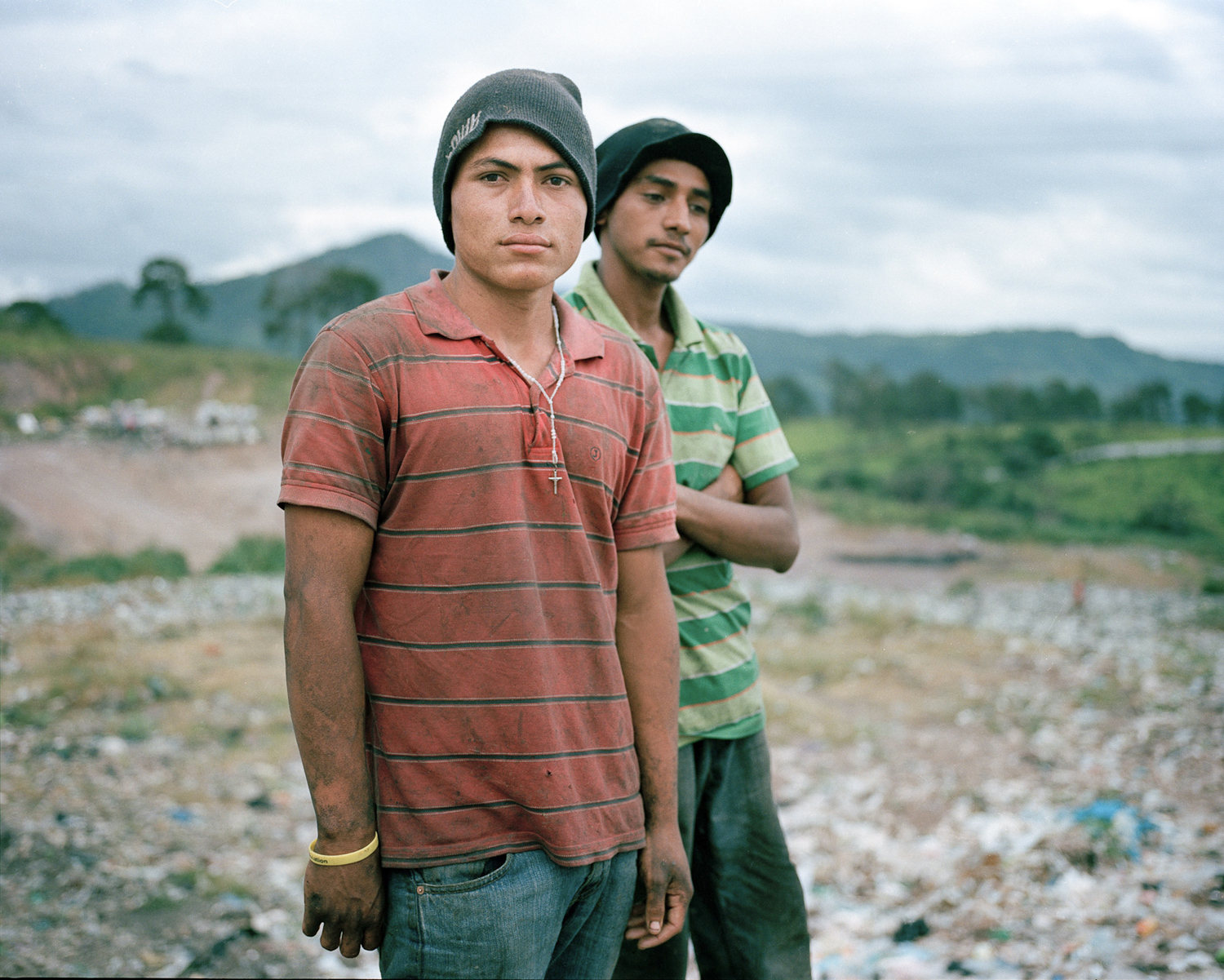 Angel and Gerson pose for a portrait in the municipal dump where they work in Tegucigalpa.