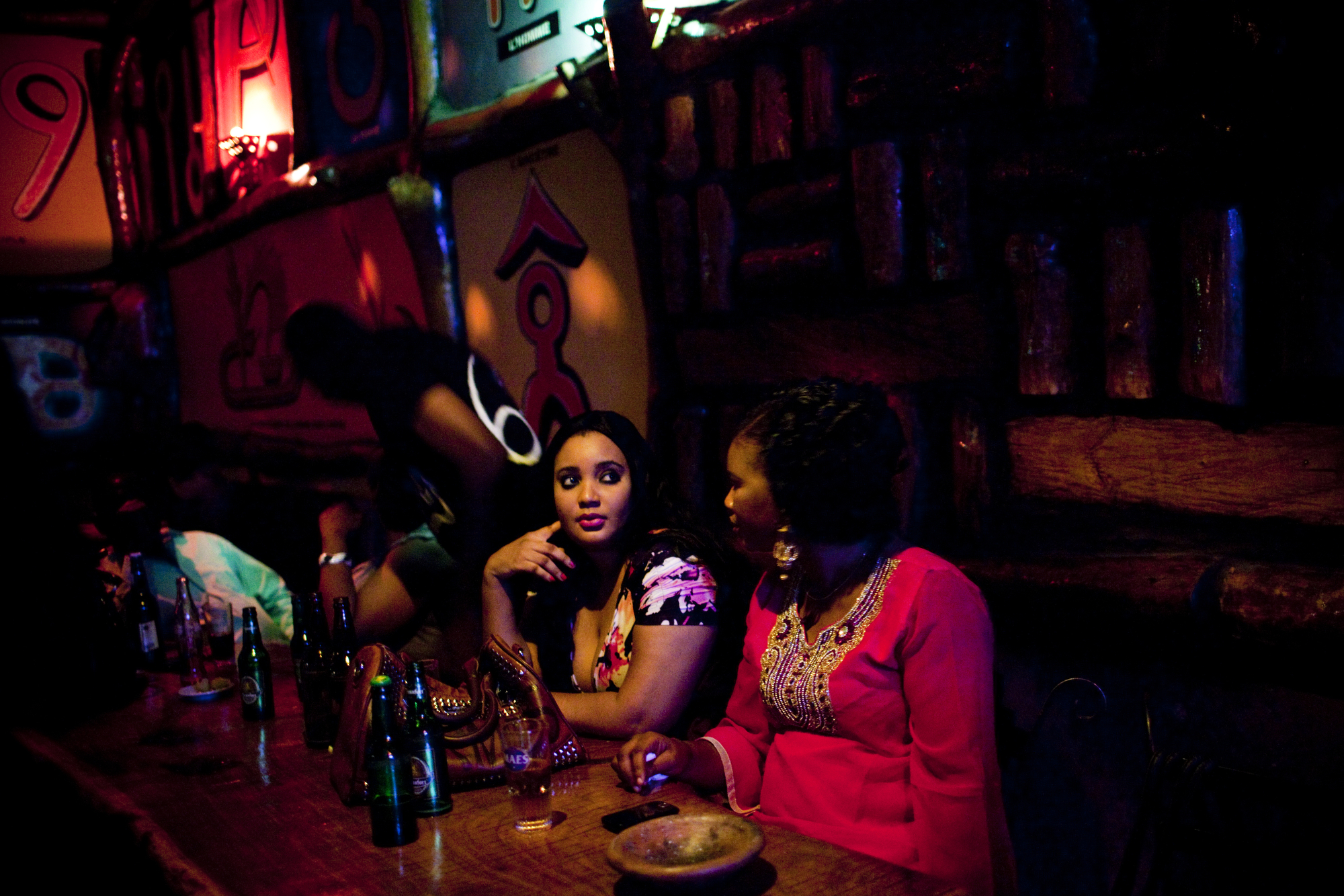Women at a bar in Bamako, Mali. A combination of fear after the 2012 conflict and a a rising conservative Islamist wave in Malian society has led to the shuttering of many establishments that serve alcohol, even in the capital.