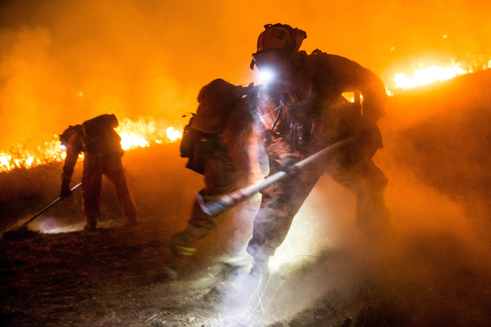 Antelope convict firefighters dig a fire line as the Butte Fire approaches near San Andreas, California, September 12, 2015.