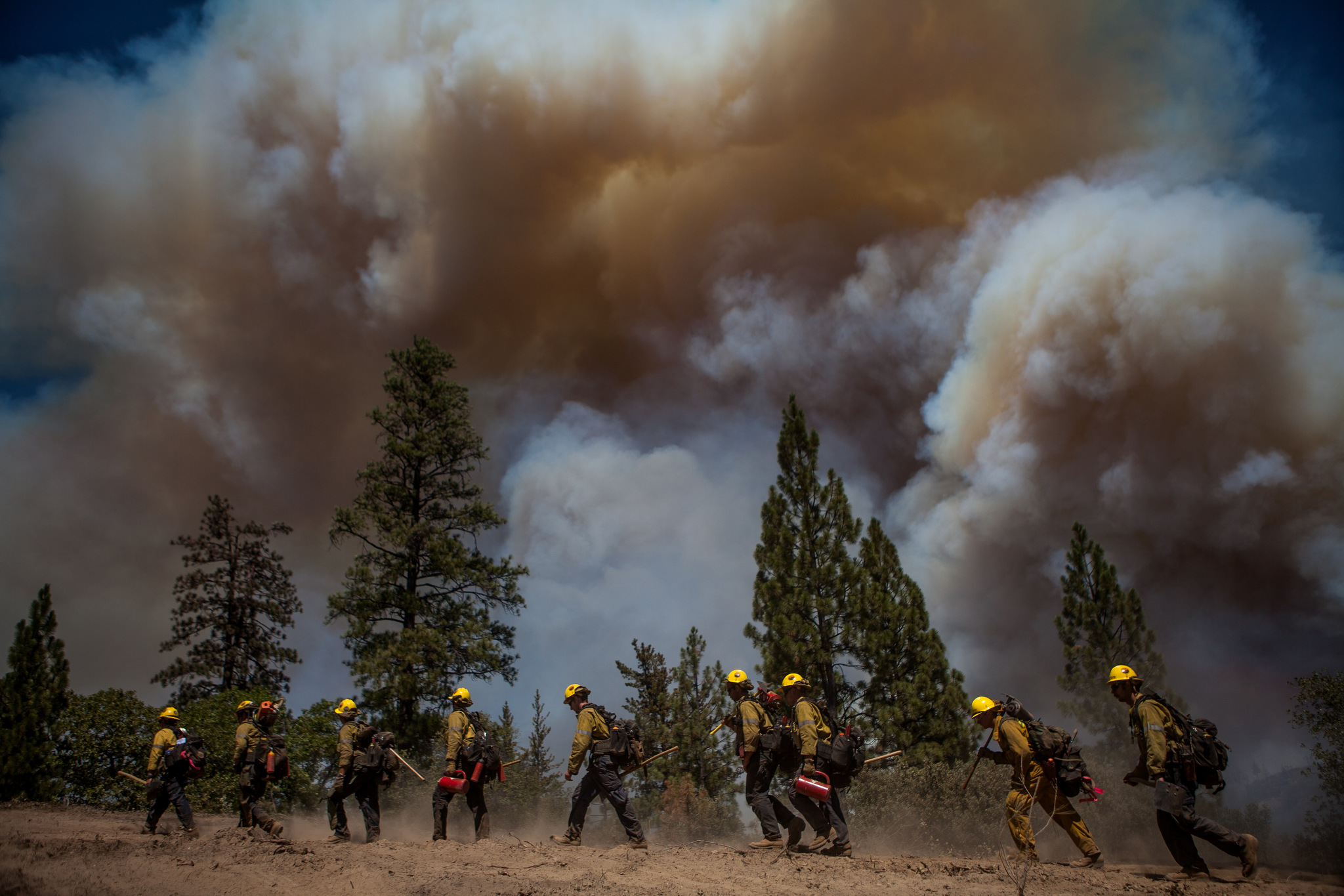 Los Angeles County firefighters hike in on a fire line on the Rim Fire near Groveland, California, August 22, 2013. The Rim Fire burned 257,314 acres and is the third largest wildfire in California history.
