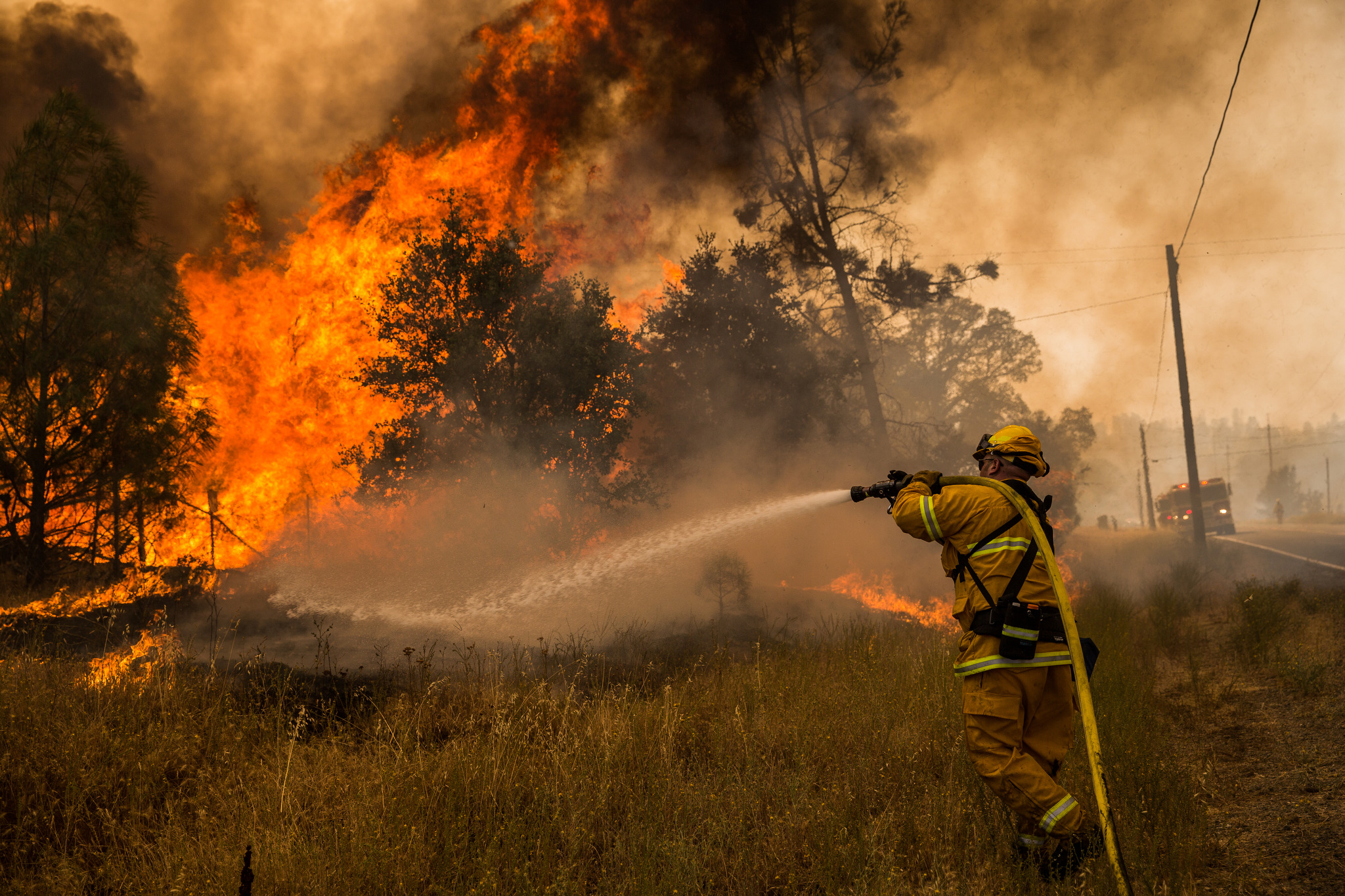 A firefighter battles a spot fire on the Rocky Fire in Lake County, California on July 30, 2015. As of August 5, the fire had consumed 69,600 acres and is one of 23 wildfires burning in California.