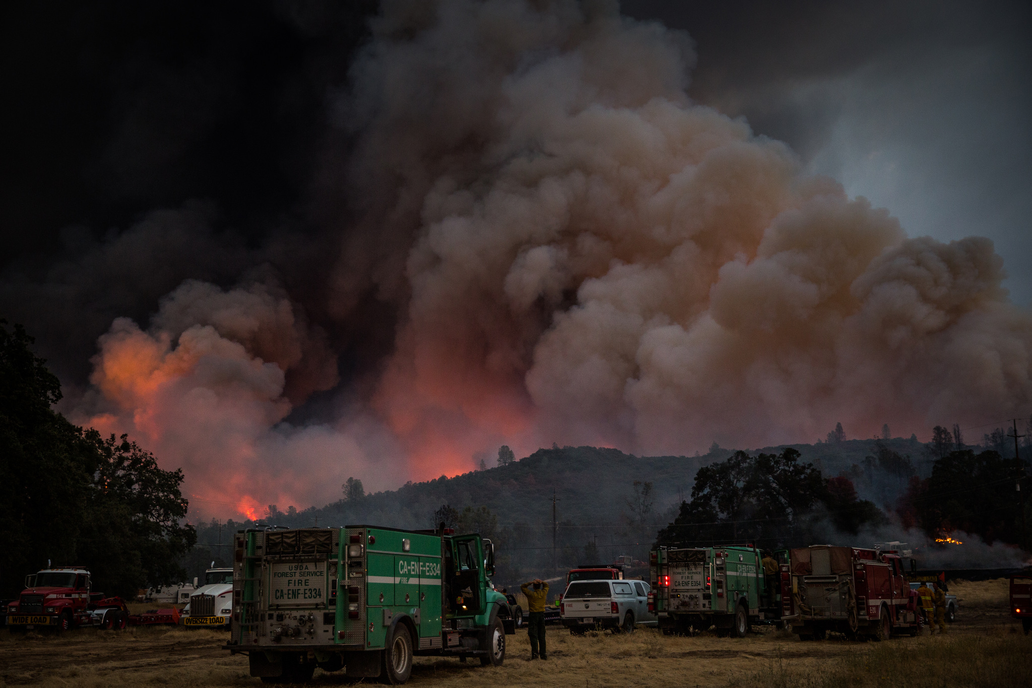 Firefighters watch the Rocky Fire advance in Lake County, California on July 30, 2015. As of August 5, the fire had consumed 69,600 acres and is one of 23 wildfires burning in California.