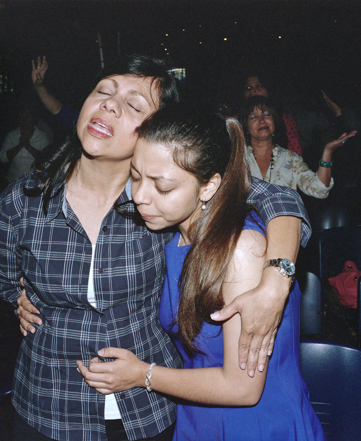 A mother and her daughter at an evangelical church.
