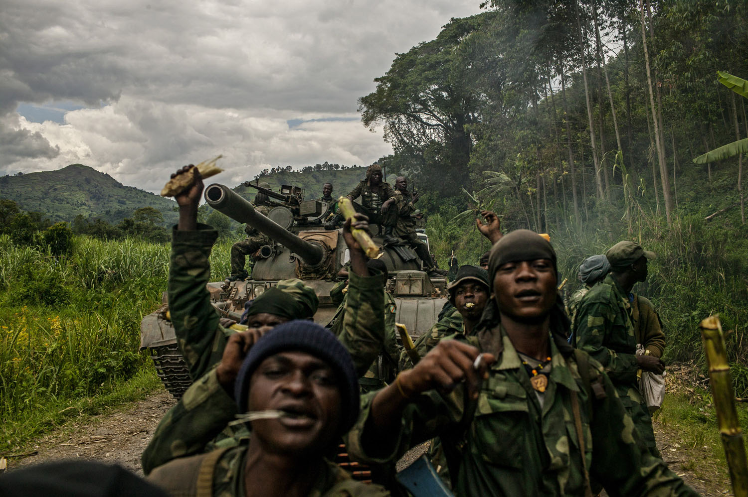 Congolese soldiers celebrate as they advance up the mountainous road toward Bunagana, the last remaining stronghold of the M-23 rebels on Wednesday.