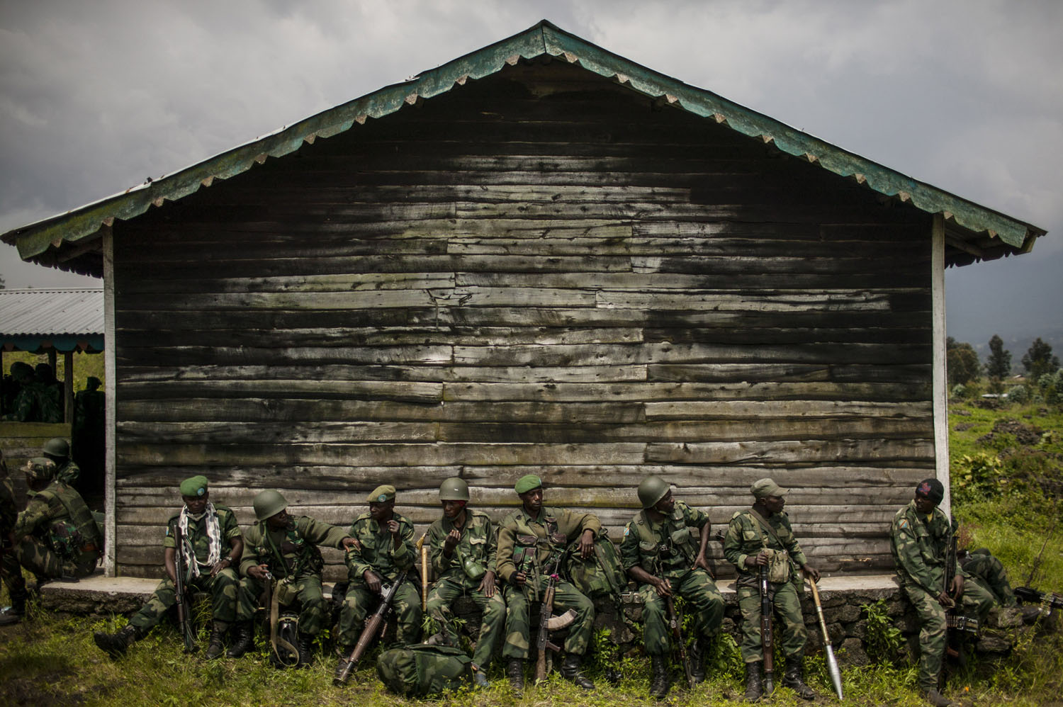 Congolese forces rest before an offensive to dislodge remaining elements of the M23 rebel group in the hills outside Kibumba, north of Goma.
