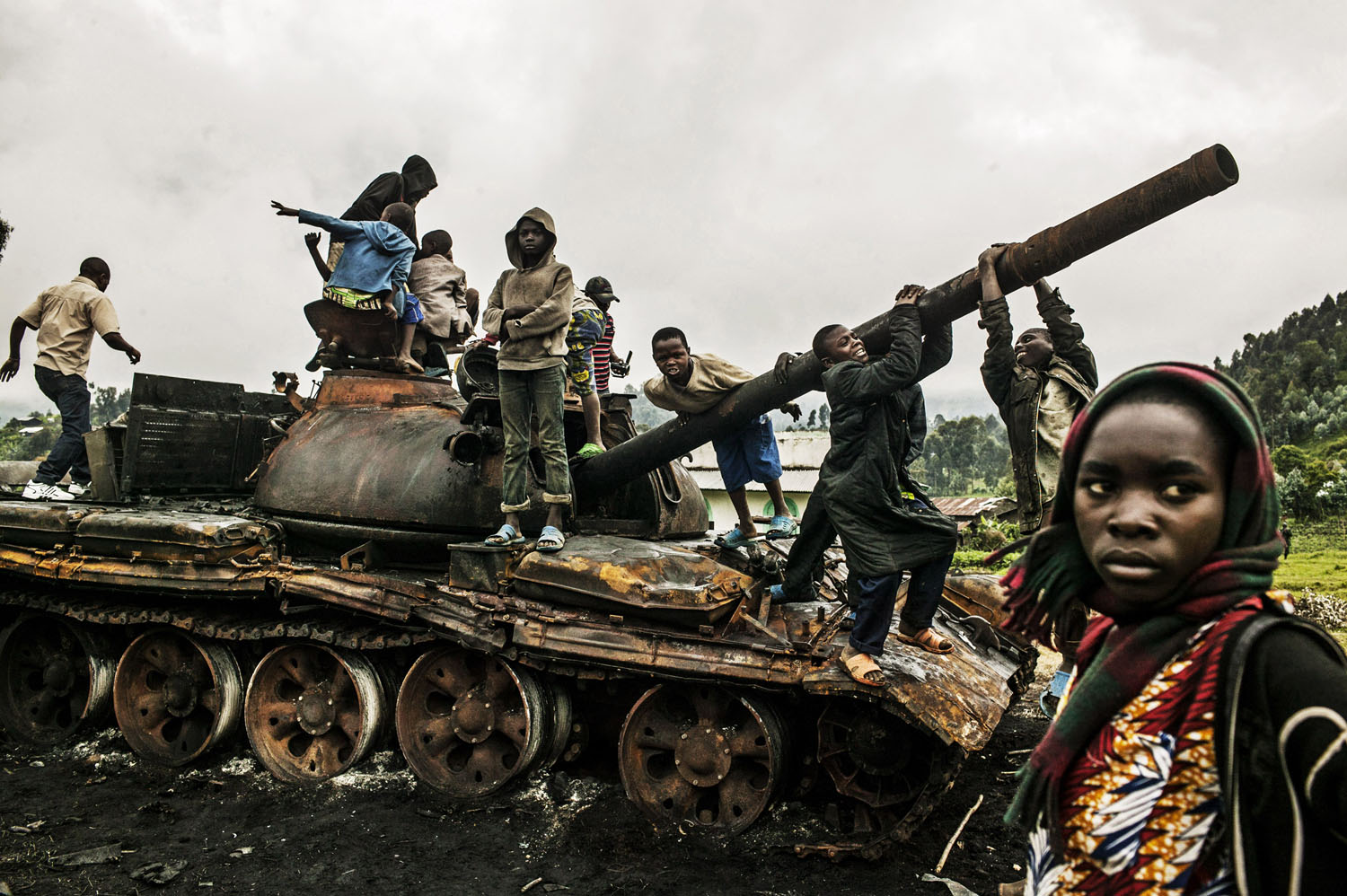 Congolese children play on a destroyed M-23 tank near Kibumba, north of Goma on Tuesday. Kibumba was the site of heavy fighting between the Congolese army and M-23 rebels on Sunday.