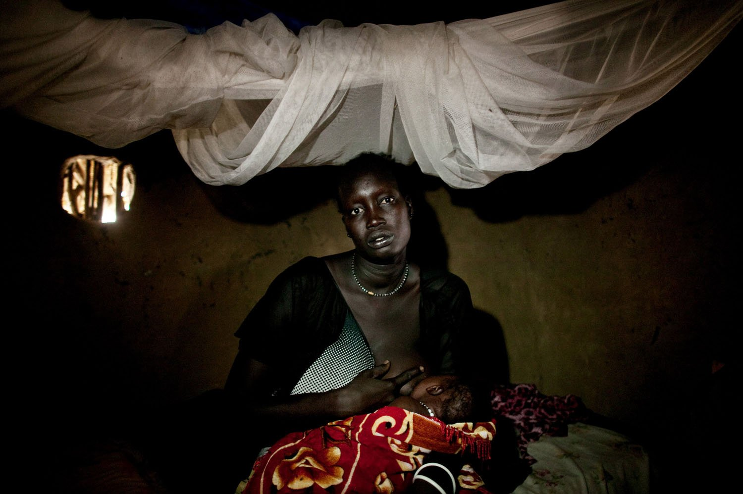 A survivor of a recent massacre in Fangak, southern Sudan on Thursday, April 7, 2011. The massacre occurred when forces loyal to rebel General George Athor attacked the to town of Fangak on Feb 9th and 10th, 2011. When the fighting ended, more than 200 people were dead, many of whom were civilians. Gen. Athor began a rebellion in April 2010 after losing gubernatorial elections in southern Sudan's Jonglei state. The rebellion has expanded significantly since then with large numbers of youth joining Athor's ranks. Southern Sudan is set to become the world's newest country in July 2011.