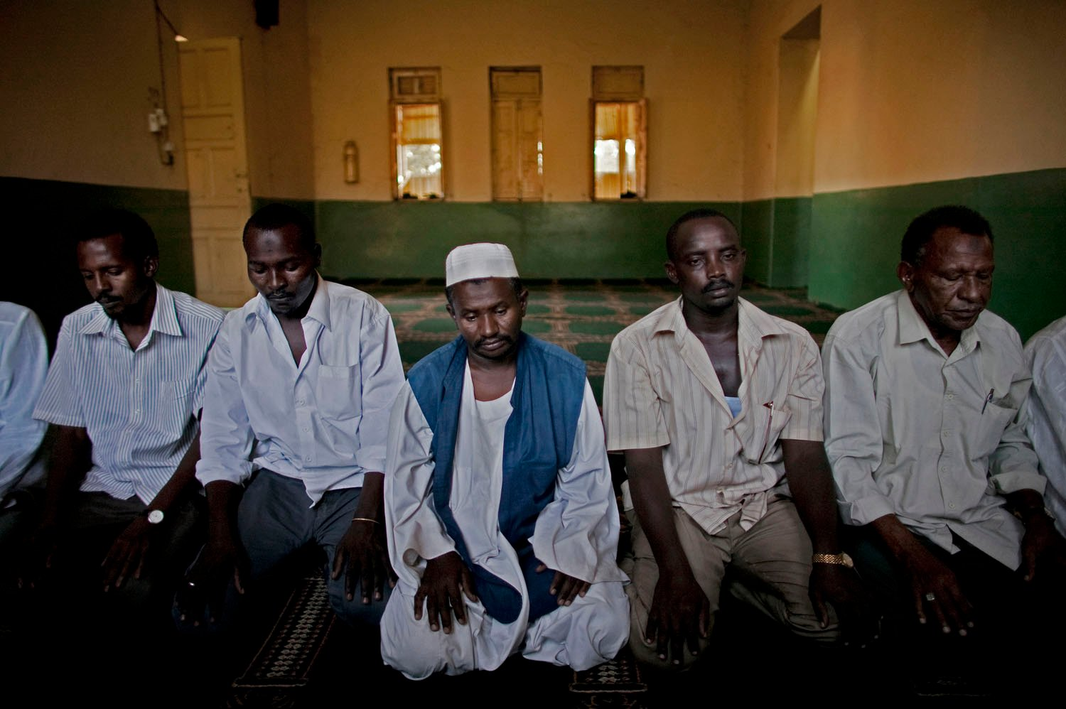 Northern Sudanese traders pray at a mosque in the volatile southern town of Malakal. Thousands of northerners live in the south where they own businesses and facilitate trade with the north. Such traders are the commercial lifeline between southern border towns that are cut off from Juba and therefore dependent on goods from the north. As the south approaches independence, the citizenship and residency rights for long-term northerner traders is in question.