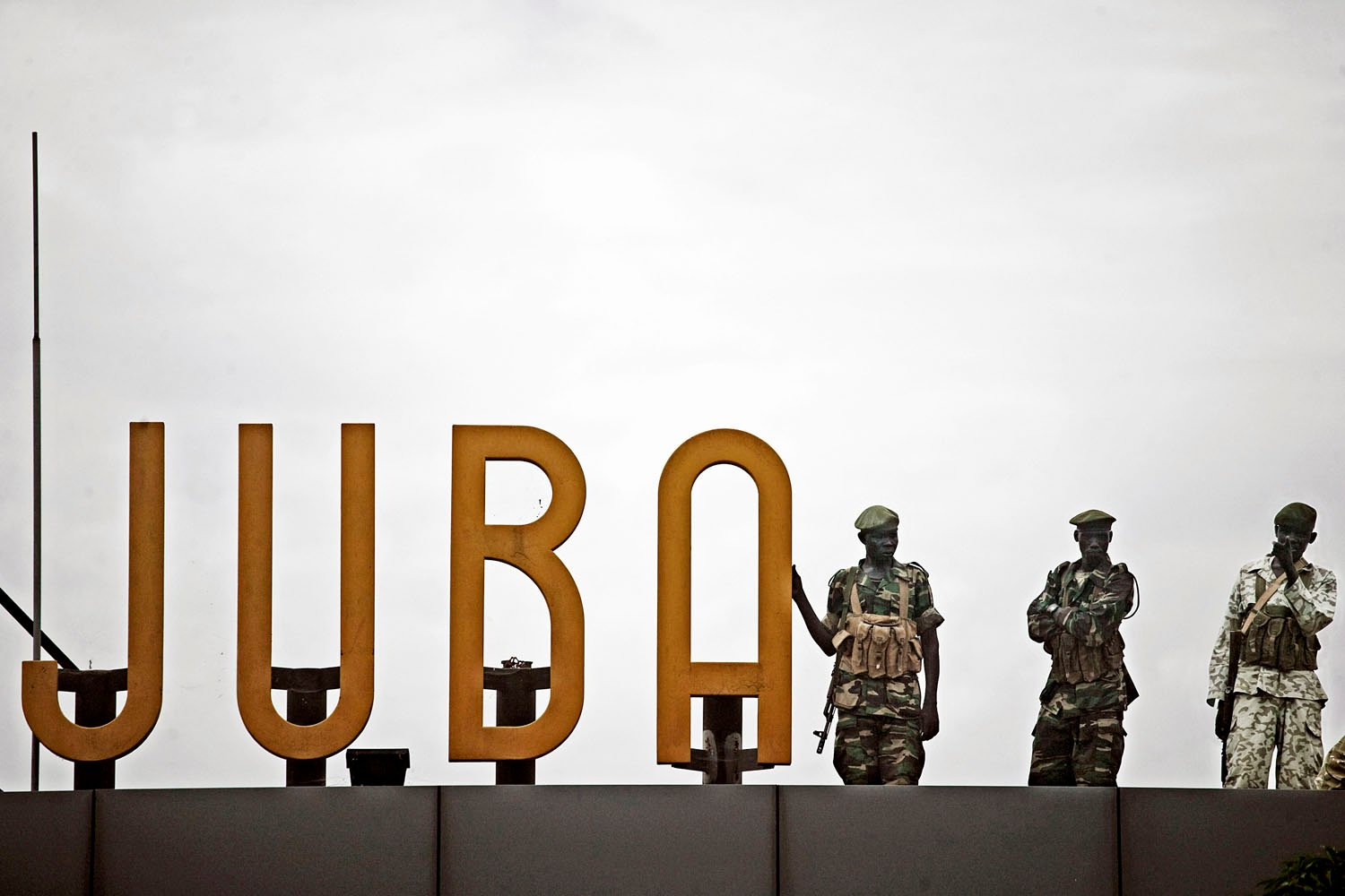 Southern soldiers stand guard on the roof of the airport in Juba, southern Sudan's defacto capital city.