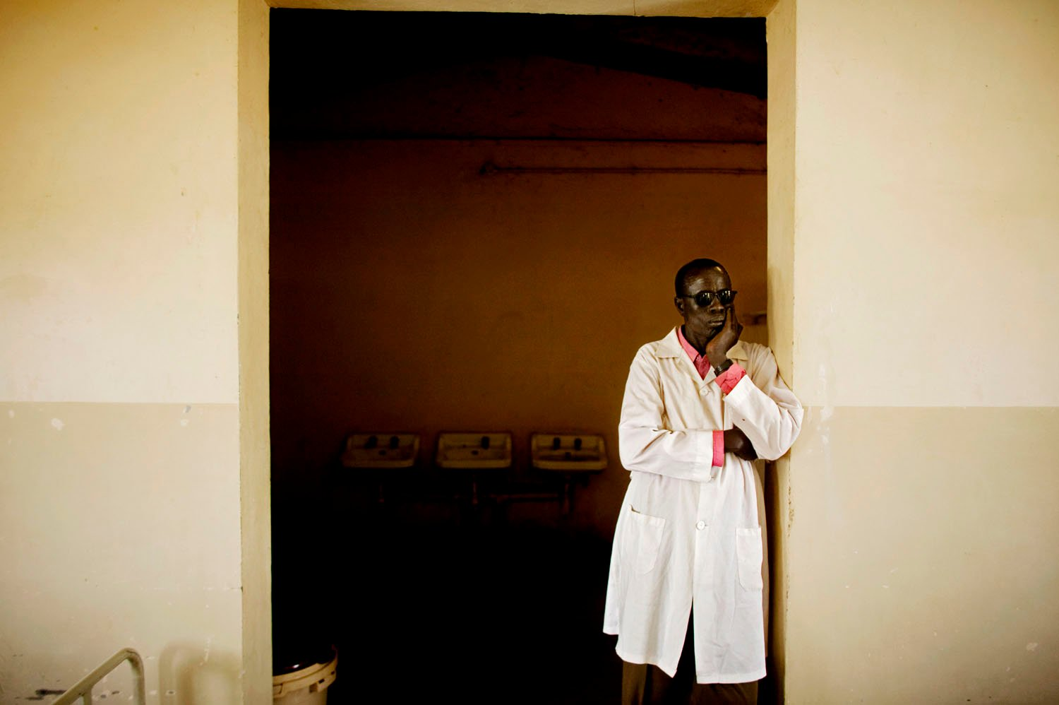A southern Sudanese doctor looks out over the male surgical recovery ward the main hospital in Bentiu, the capital of southern Sudan's oil rich Unity State. The state of medical care in  the south is dismal with too few, understaffed hospitals trying to deal with rampant medical challenges.