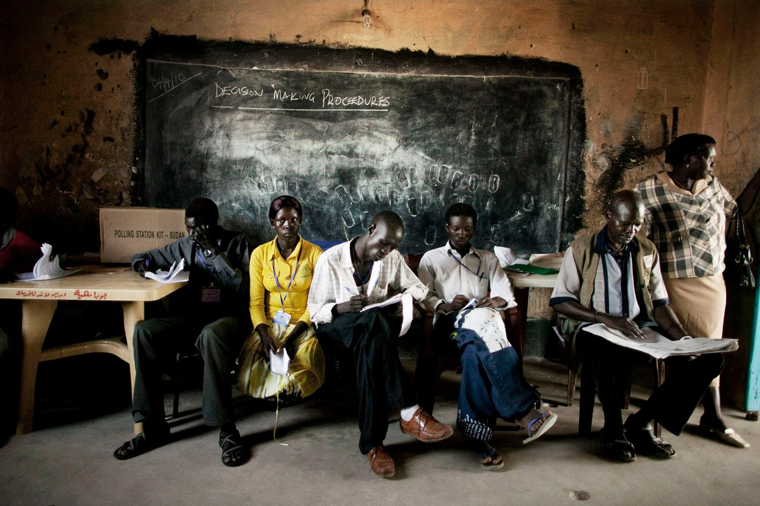Southern Sudanese election observers and political party agents sit inside a polling station in Juba, southern Sudan during the country's historic presidential, parliamentary and gubernatorial elections in April 2010. The elections were the first to take place in Sudan since 1986.