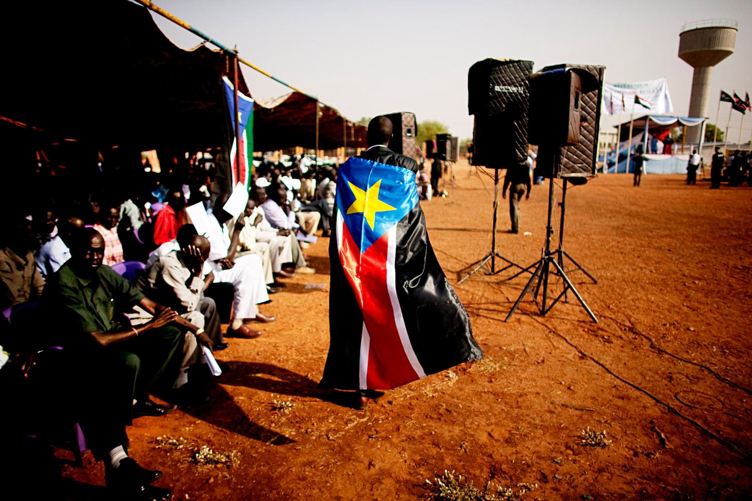 A man dons the flag of the Sudan People's Liberation Movement during a rally in Juba.
