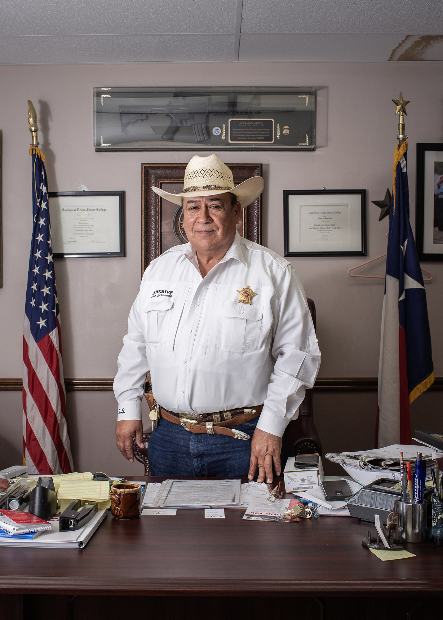 """Portrait of Maverick County Sheriff Tom Schmerber. Sheriff Schmerber presents himself against Trump's measures against immigrants and declares """"Maybe they are just looking for a better life."""" Eagle Pass, Texas, United States. June 22nd, 2018. Photographer: Luján Agusti."""