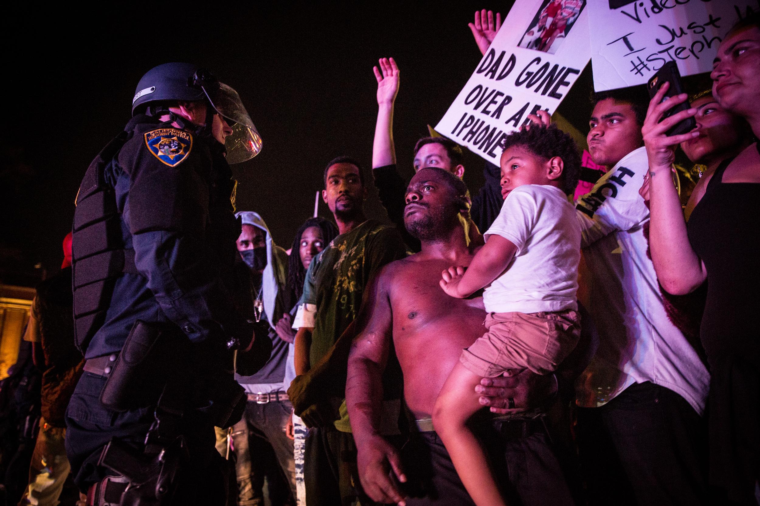 Law enforcement face off against Black Lives Matter protestors in downtown Sacramento on MArch 30, 2018.
