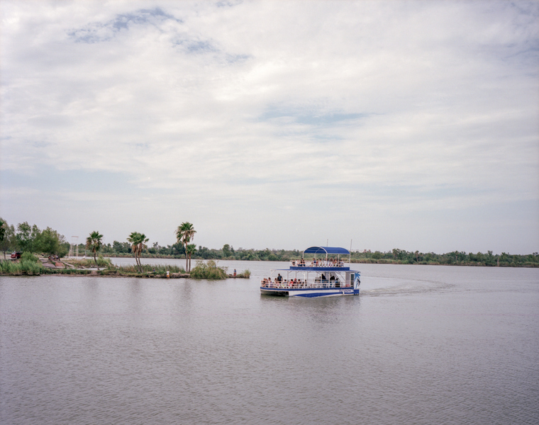 A Mexican tour boat takes tourists out on the Rio Bravo.