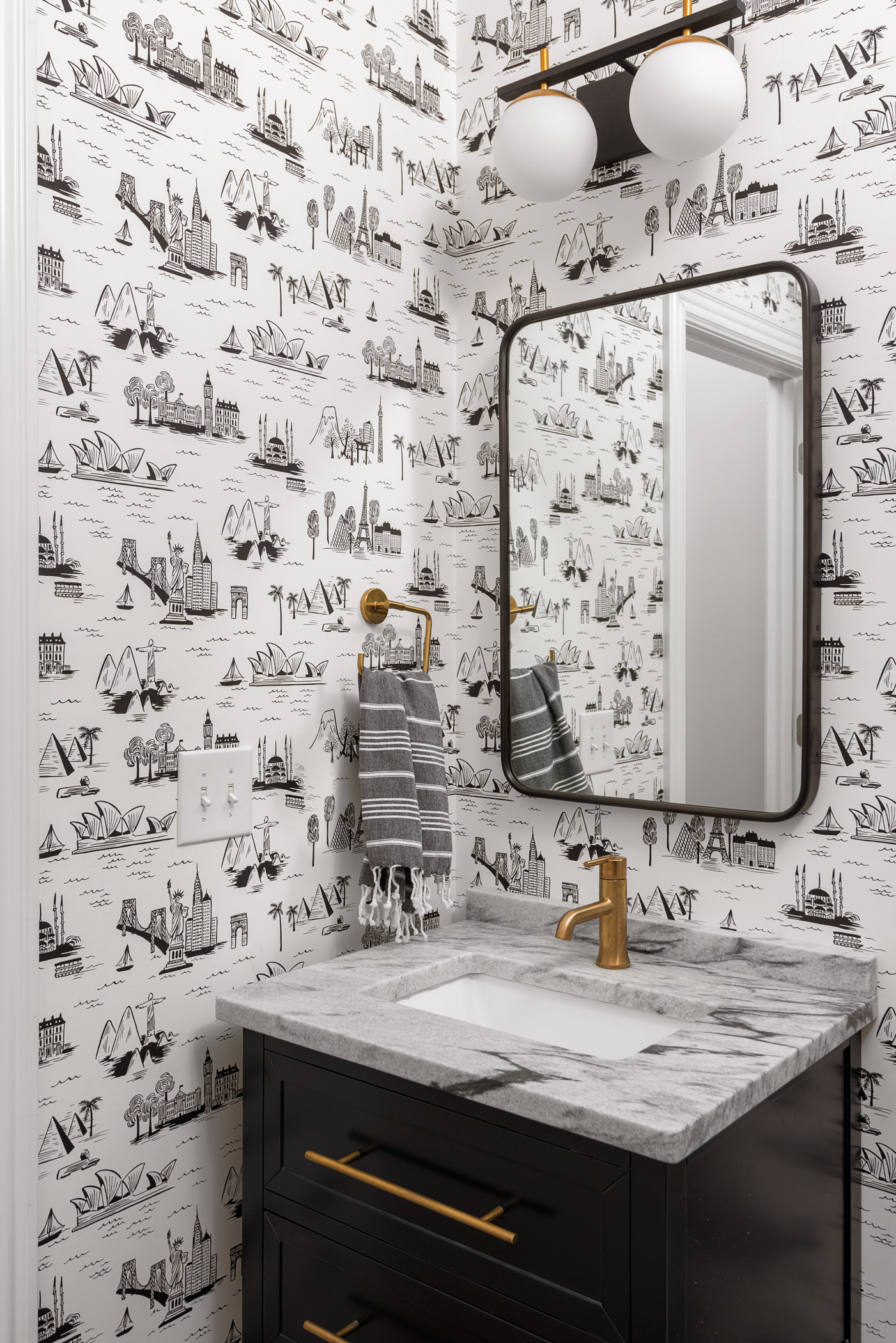 Lots of fun and whimsy packed into this tiny powder room!