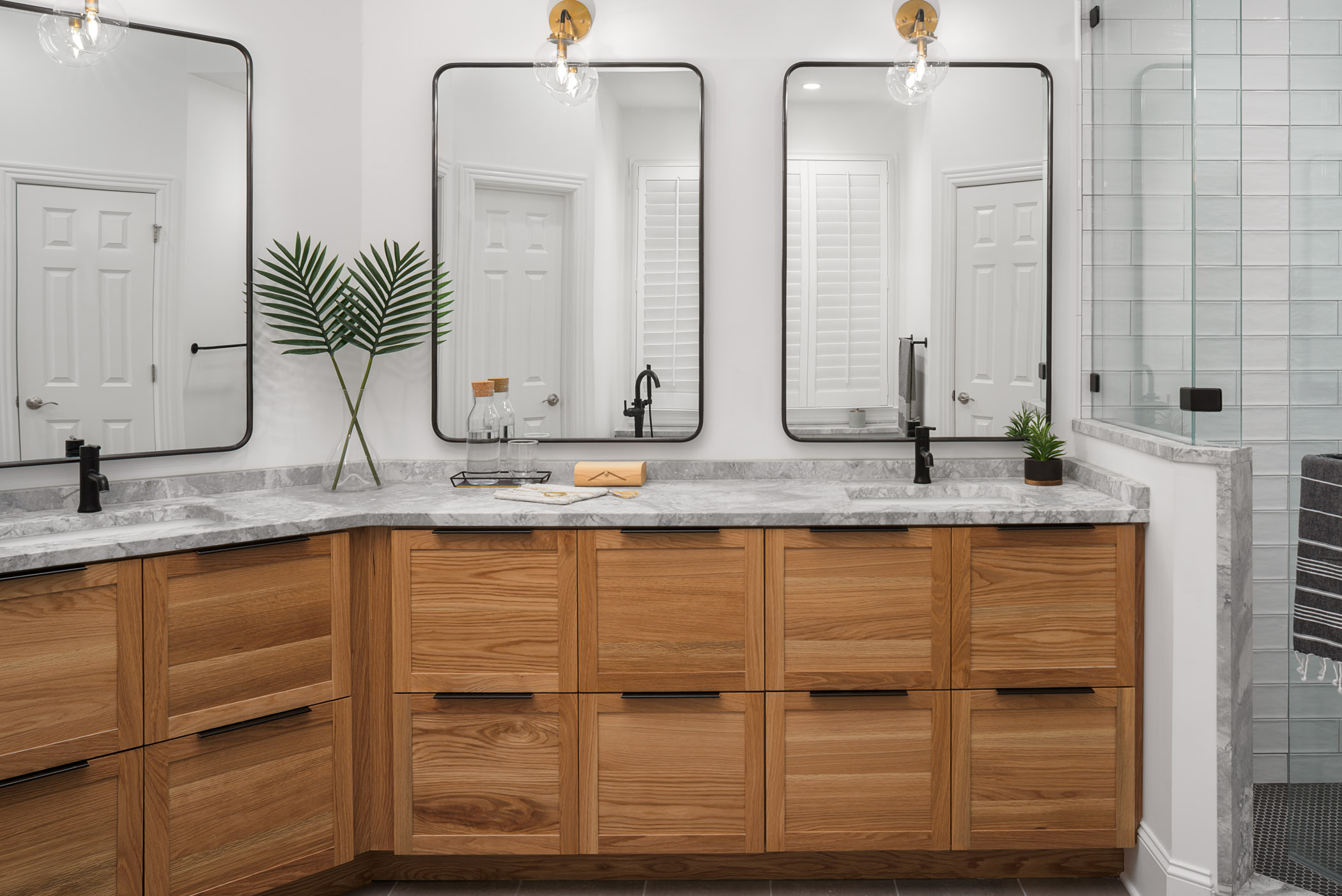 The master bathroom is arguably our favorite transformation of the whole project. Custom white oak cabinets with a honed marble top provide the perfect place to start and end everyday.