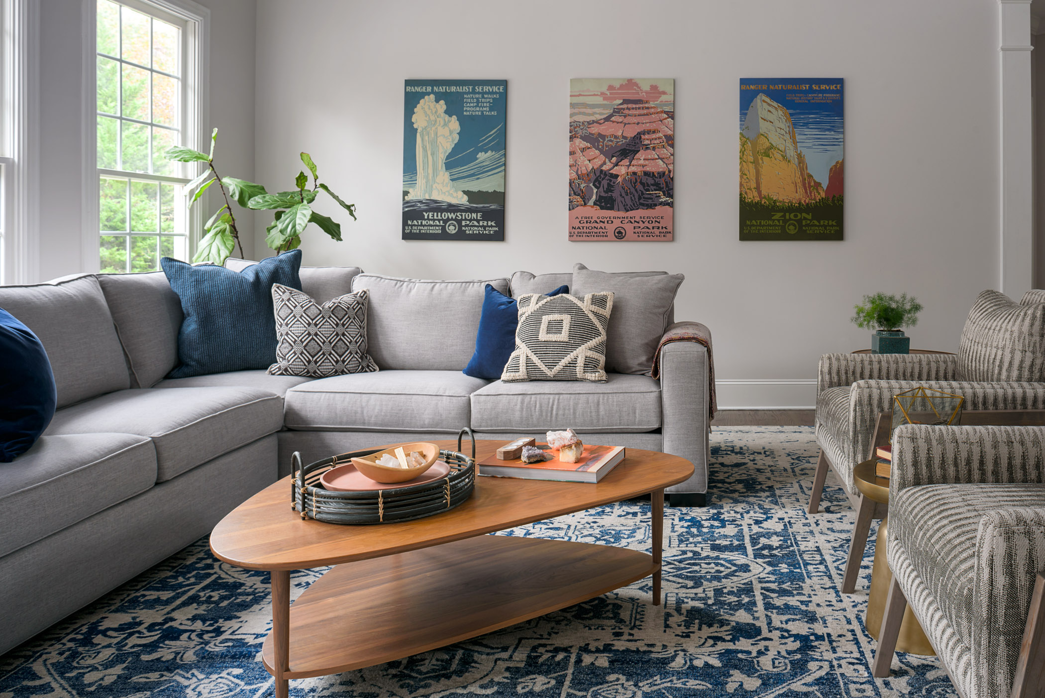 Light gray walls maximize the abundant natural light in every space of the house. We livened up a neutral palette with pops of bright blue, earth tones, and some playful patterned textiles.