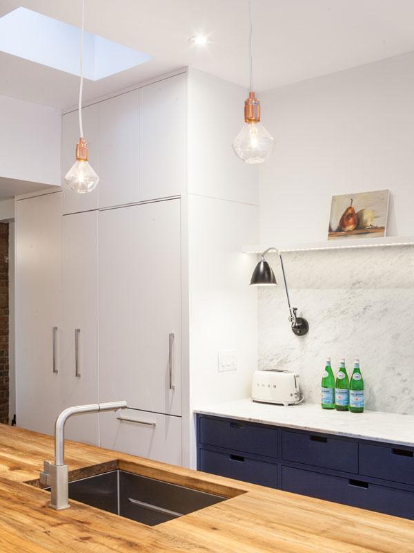 Custom Millwork: Hidden Fridge and Pantry Cabinet