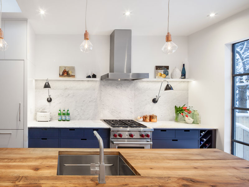 Main Kitchen Line with Marble Backsplash and Open Shelves with Recessed LED lights.