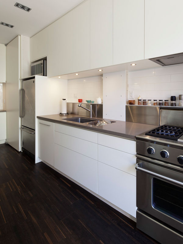 White Cabinets with Dark Engineered Wood Floor