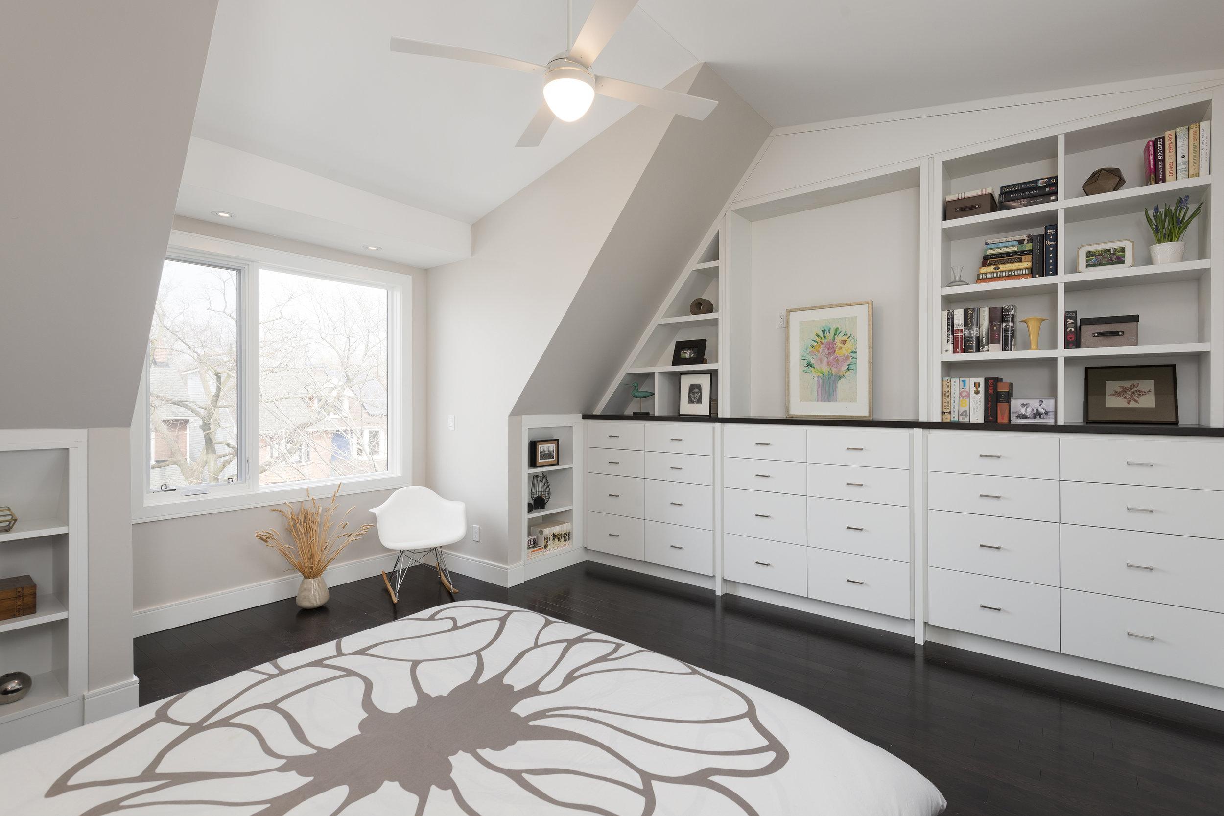 Custom Shelves along length of bedroom wall