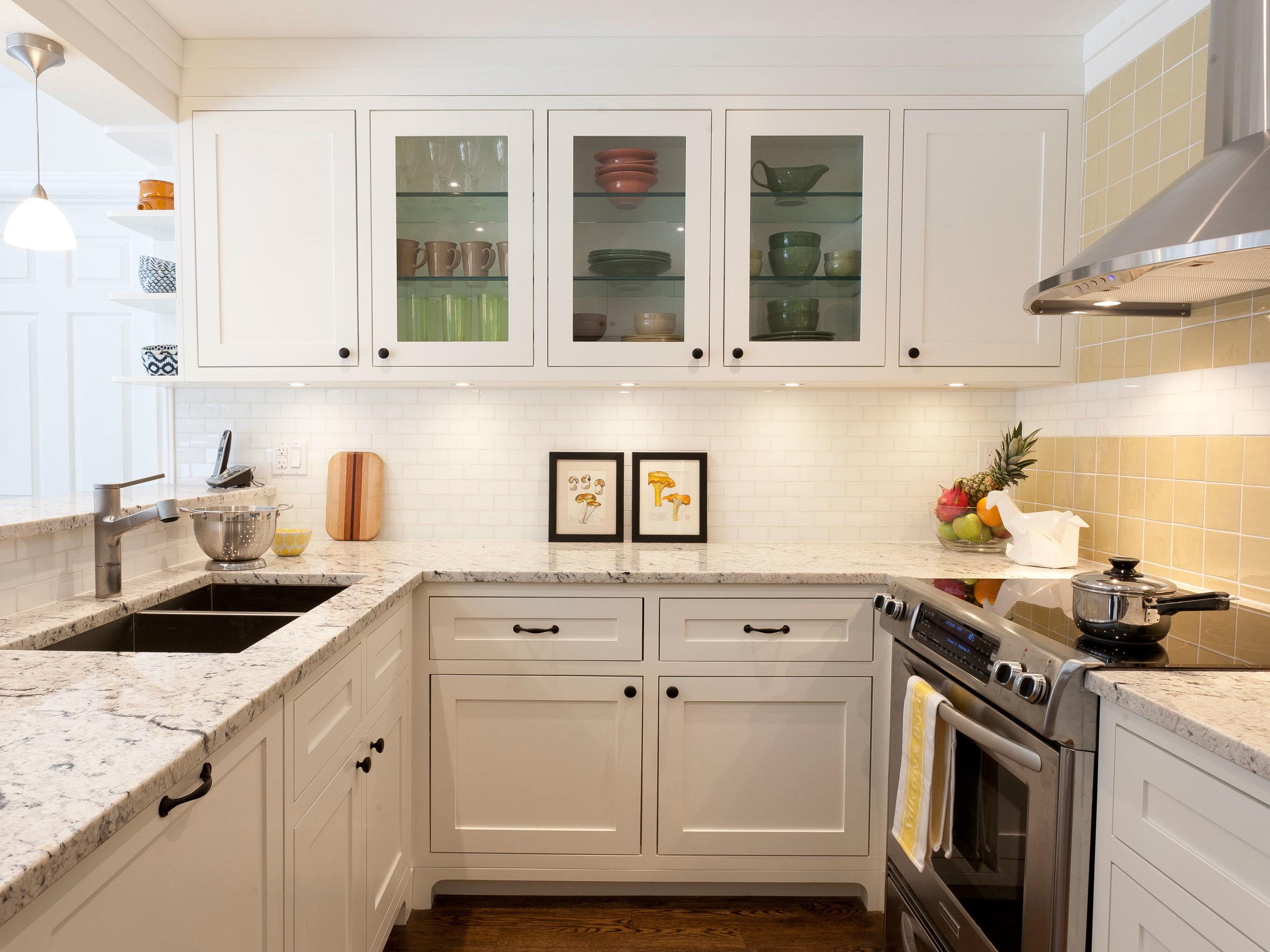 U shaped Kitchen with Glass Cabinets